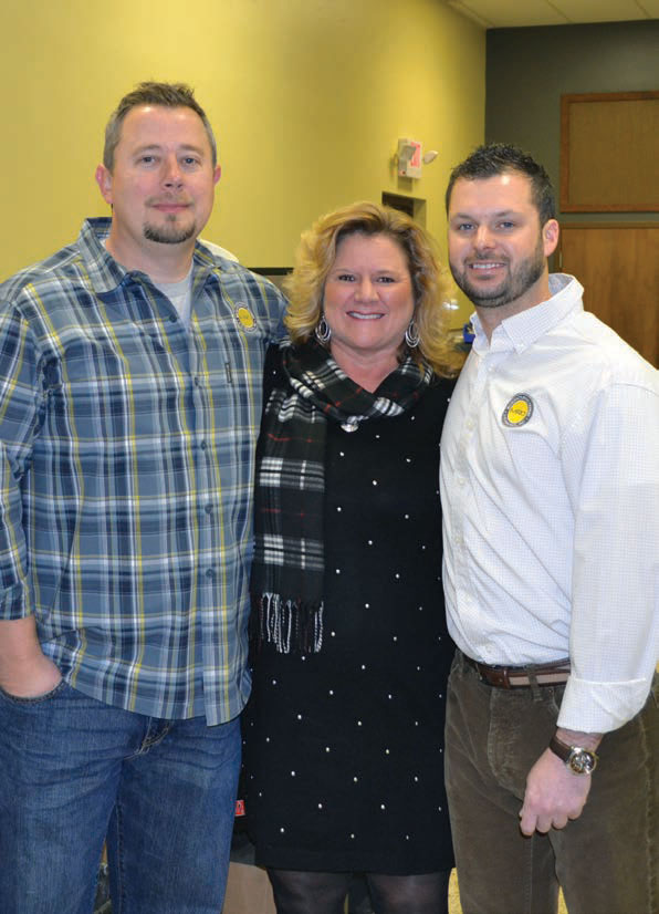 MRO's Russell Looper (left) and Justin Wilson (right) flank Kathryn Foster (center), who directs the INCubator. MRO recently became the 500th company to graduate from the program.