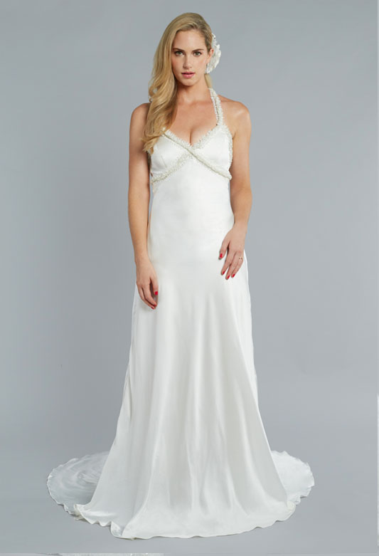 THE MOONLIGHT - A truly effortless beauty, captivating in irresistible silk that hugs the gorgeous natural curves of every bride. The intricacies of The Moonlight gown are subtle but exquisite, with beading that shimmers around the neckline and a flare that flows gracefully to the floor.