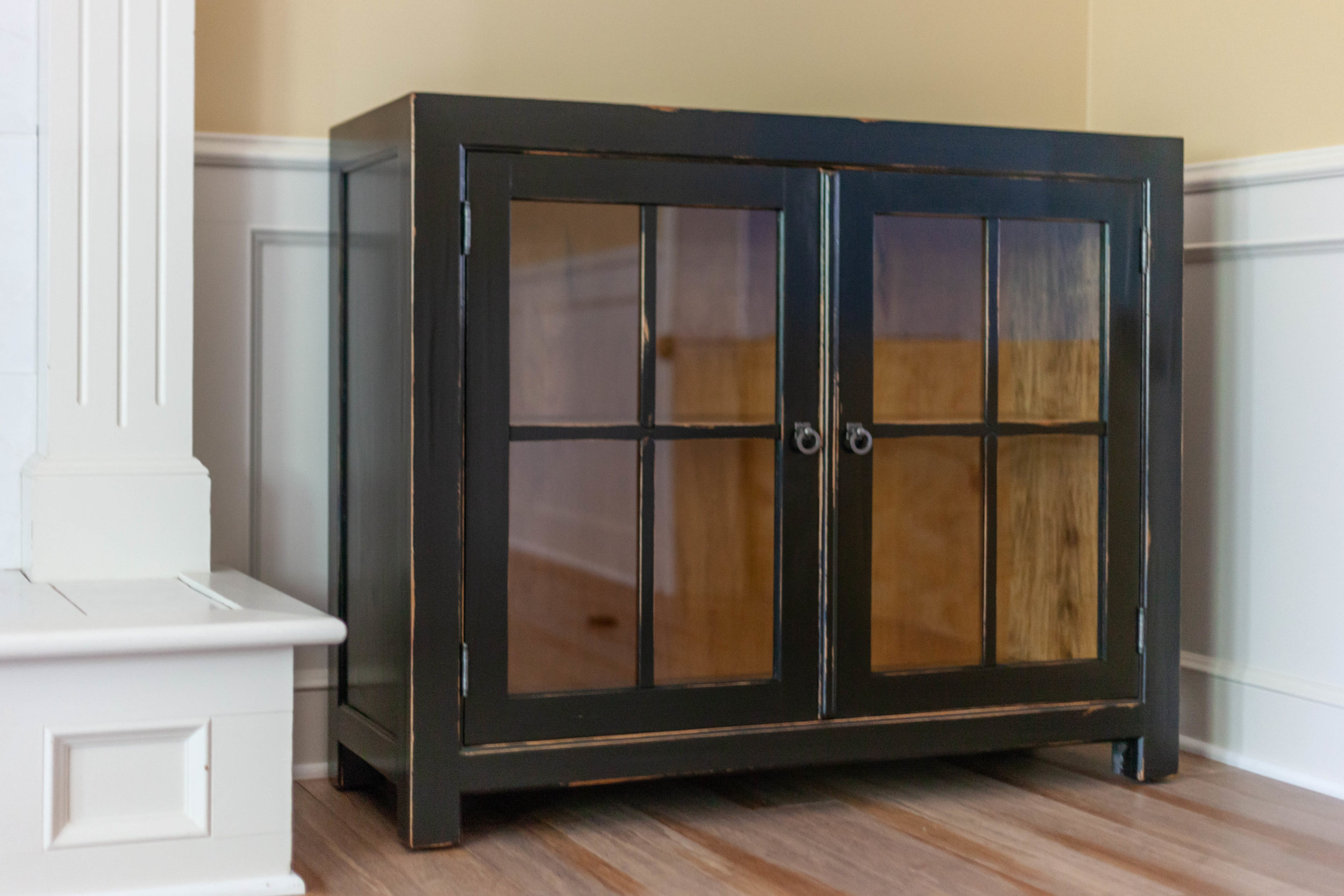 Custom media cabinet, glass panel doors, distressed black finish, maple & poplar construction