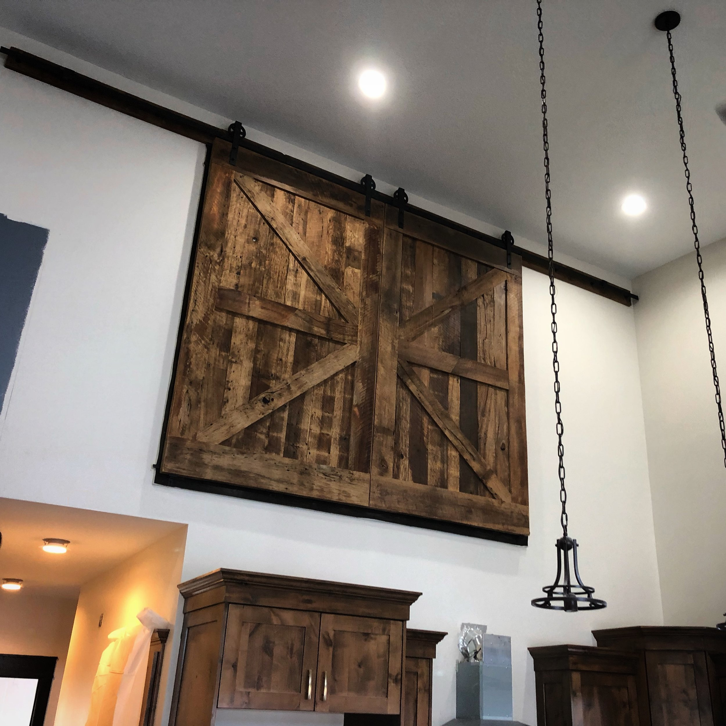 Custom built double barn doors, reclaimed barn wood construction