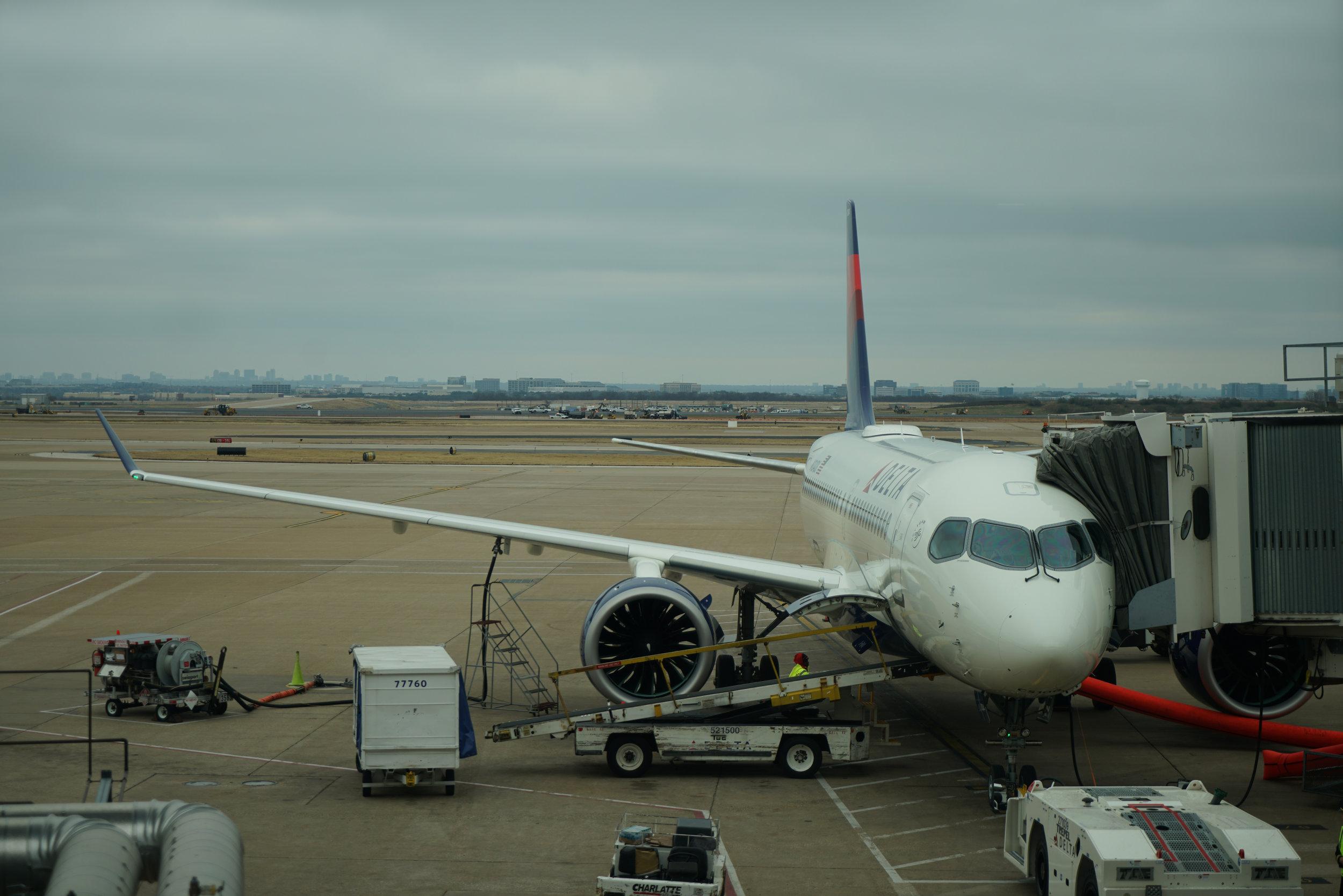 Delta A220 at DFW Gate.jpg