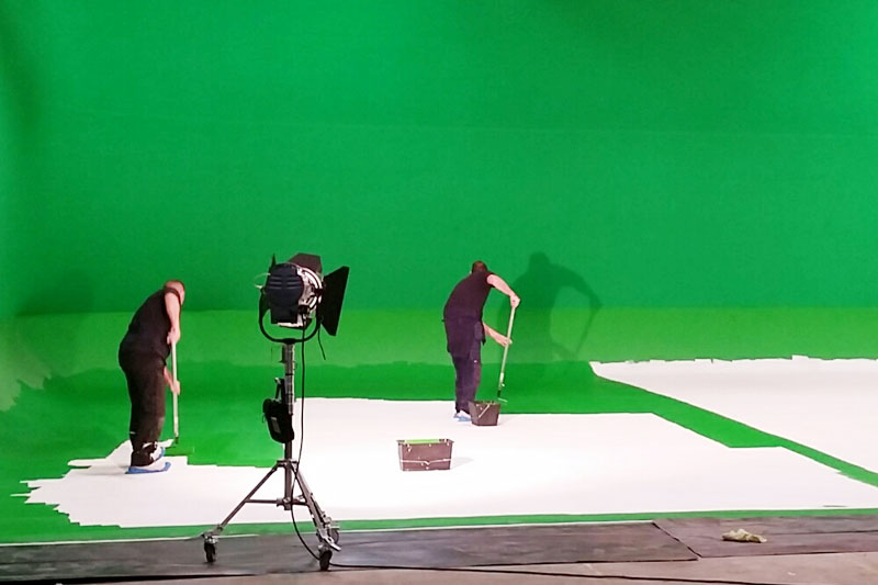 Chromakey green being painted.png