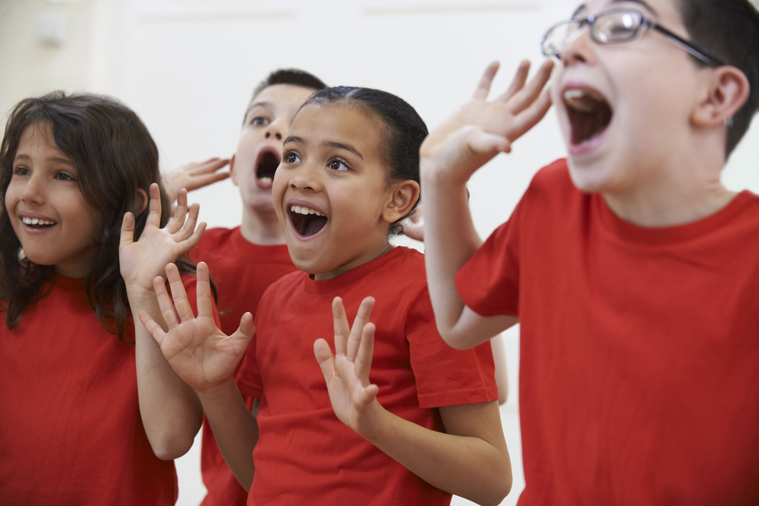 Smiling girl spreads hands performing poetry.jpg