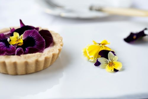 Raw viola and strawberry tart. Photography: Dawn Langley