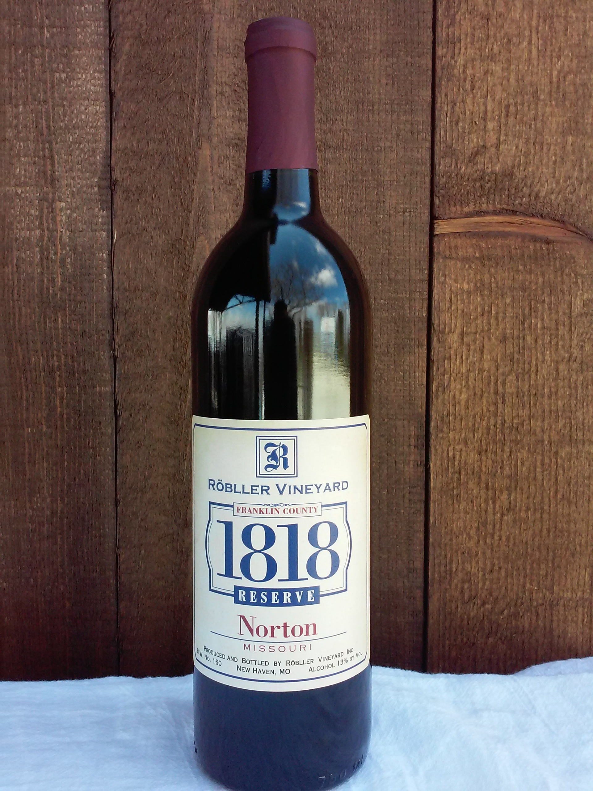1818 Reserve Norton - With this 2015 Reserve Norton, we commemorate the bicentennial of Franklin County. Our state grape and only true native wine grape of the New World, Norton has been in existence as long as our great county.From our 25-plus-year-old vines, the 2015 vintage created exceptional fruit full of land character, structure and balance. The finished wine was initially refined for two years in neutral Missouri White and Chinkapin Oak barrels with an additional year in new heavy toast Chinkapin barrels, creating a robust yet elegant wine of distinction. This limited production wine can be enjoyed today and will enhance with cellaring.