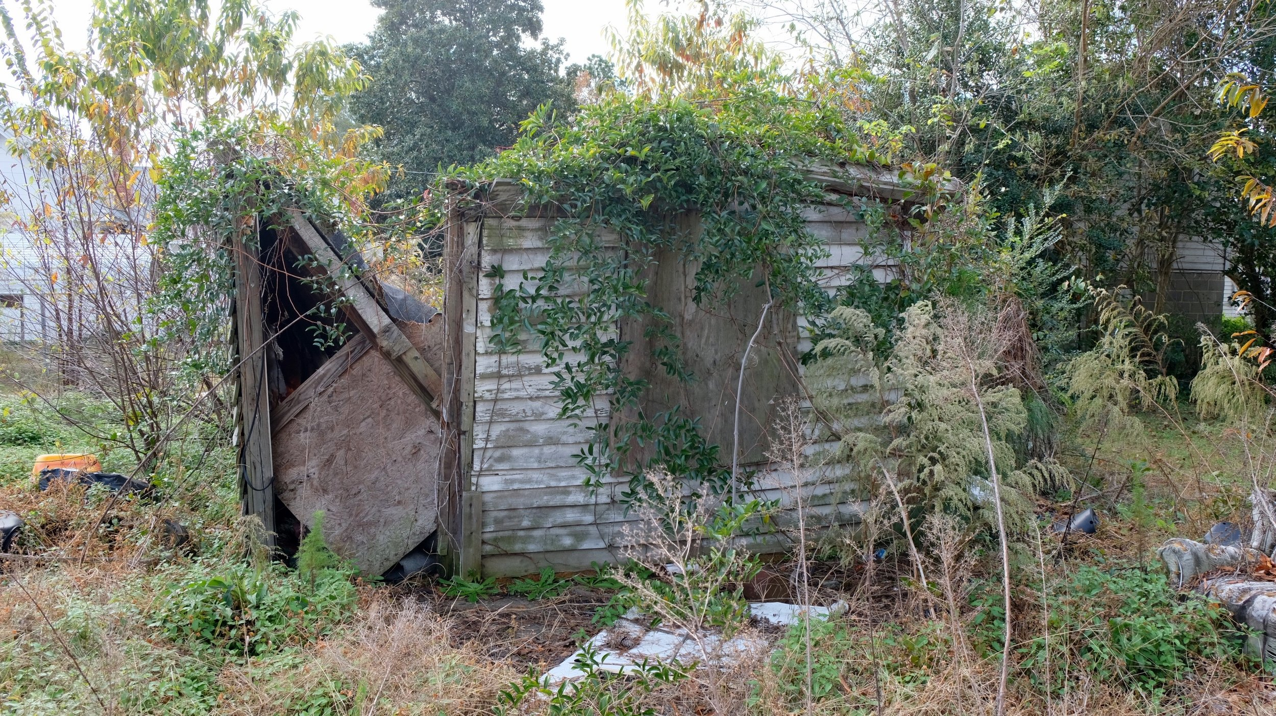 A dilapidated wooden structure just feet from where Megan Oxendine was found dead and decomposing. (Photo by Russ Bowen)