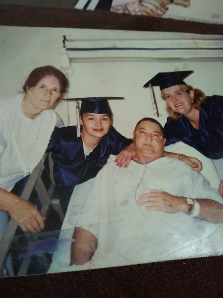 Rhonda Jones (in blue on left) with her family after graduation.