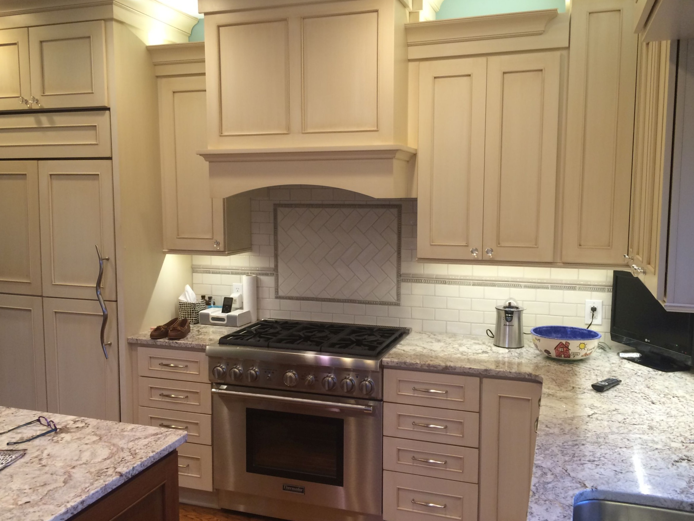 Kitchen remodel: New counter tops, cabinets, flooring, back splash, appliances, hidden fridge, kitchen island, and more.