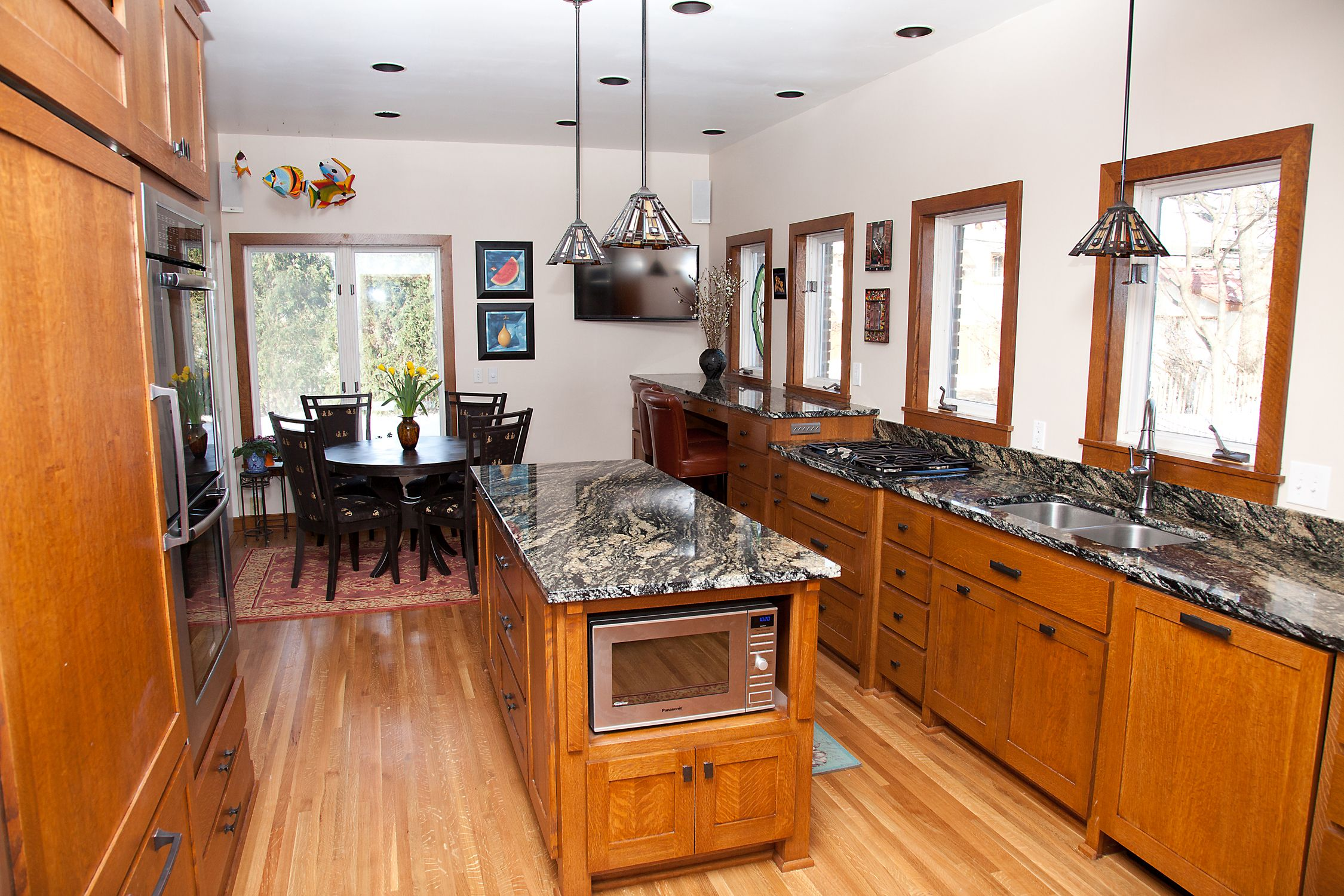 Kitchen remodel with updated island, cabinets, flooring, counter tops, and more.