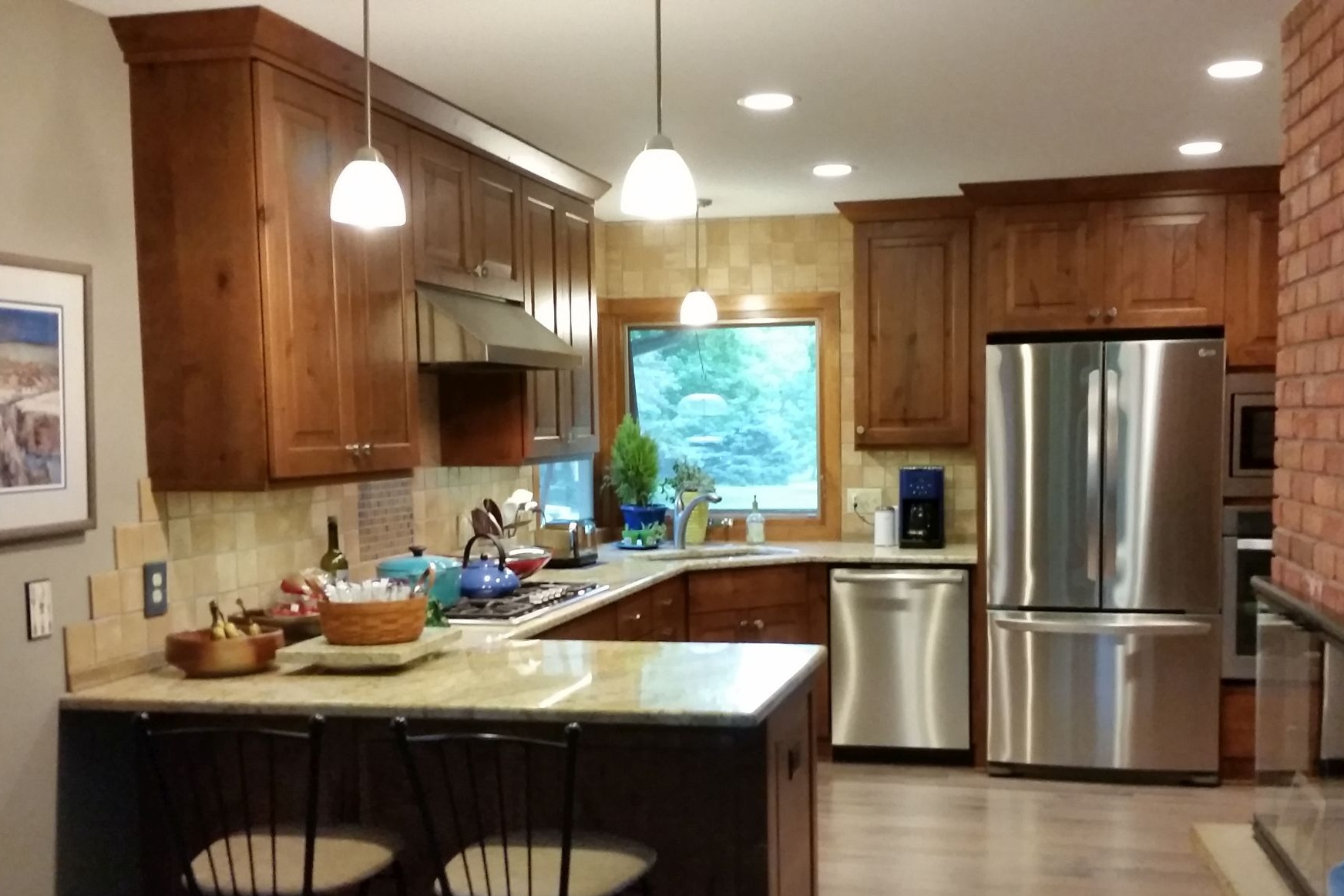 Kitchen remodel with updated layout, new cabinets, and new appliances.
