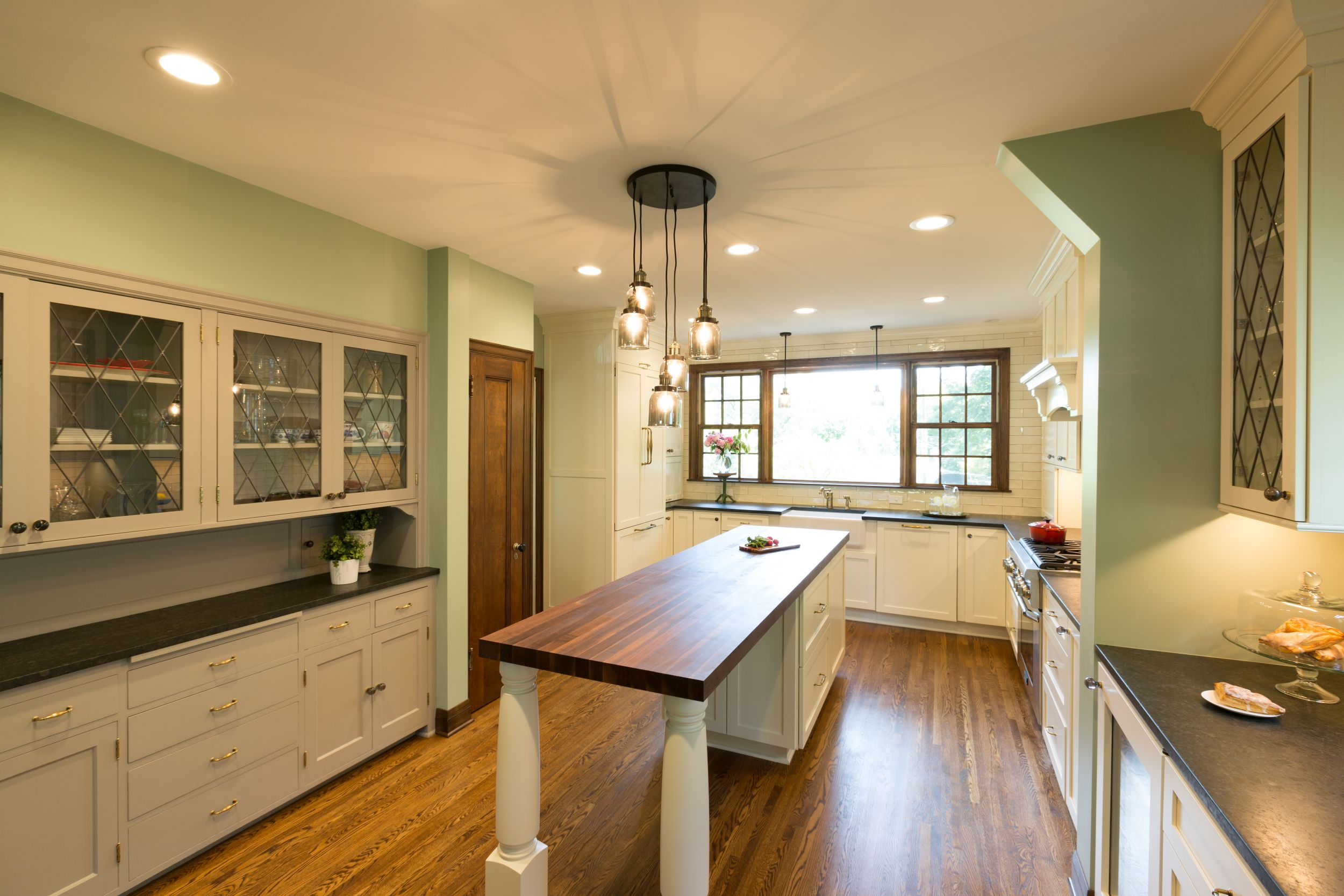 Kitchen remodel with large, butcher block island.