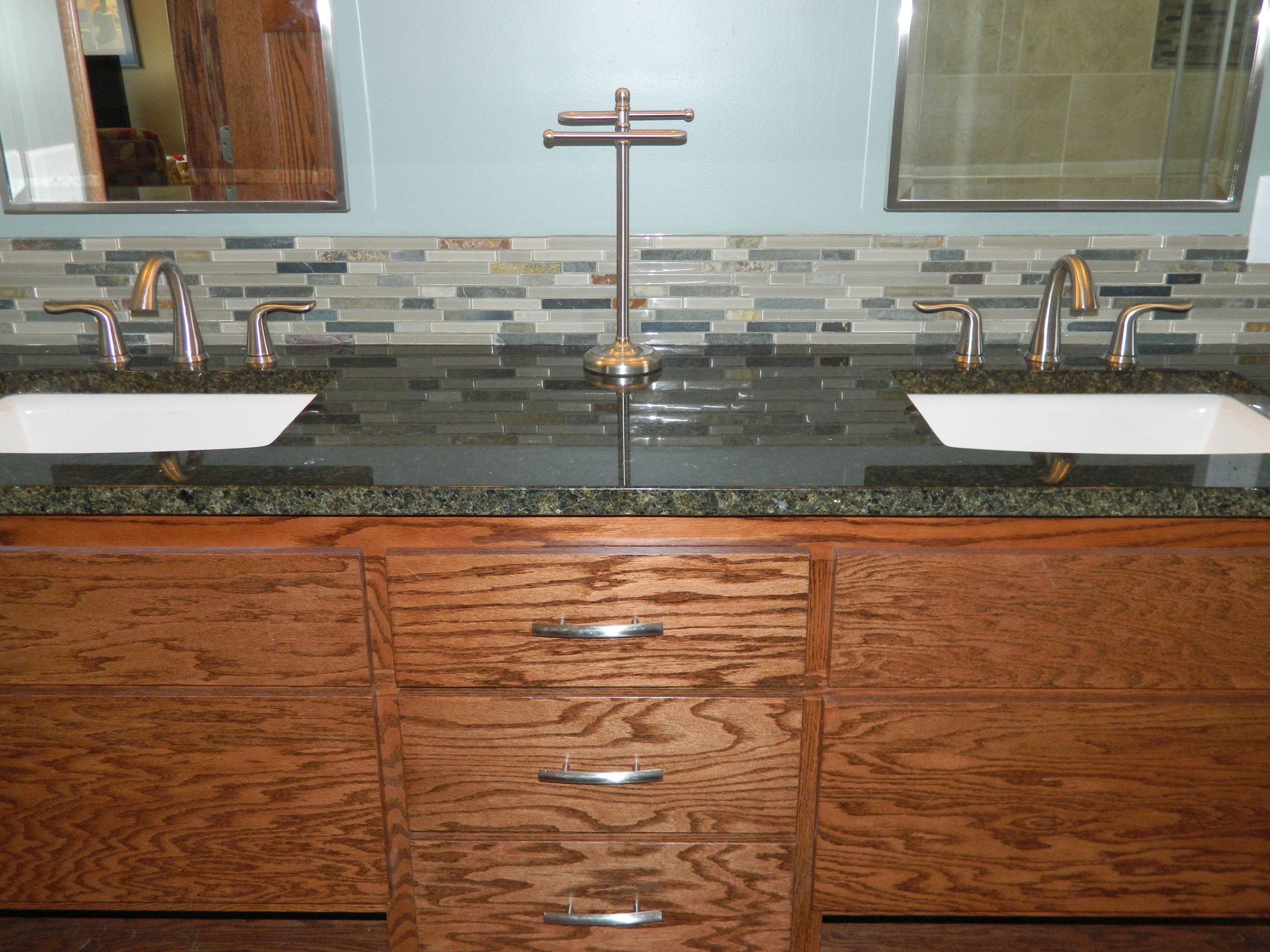 Bathroom remodel with double vanity and back splash.