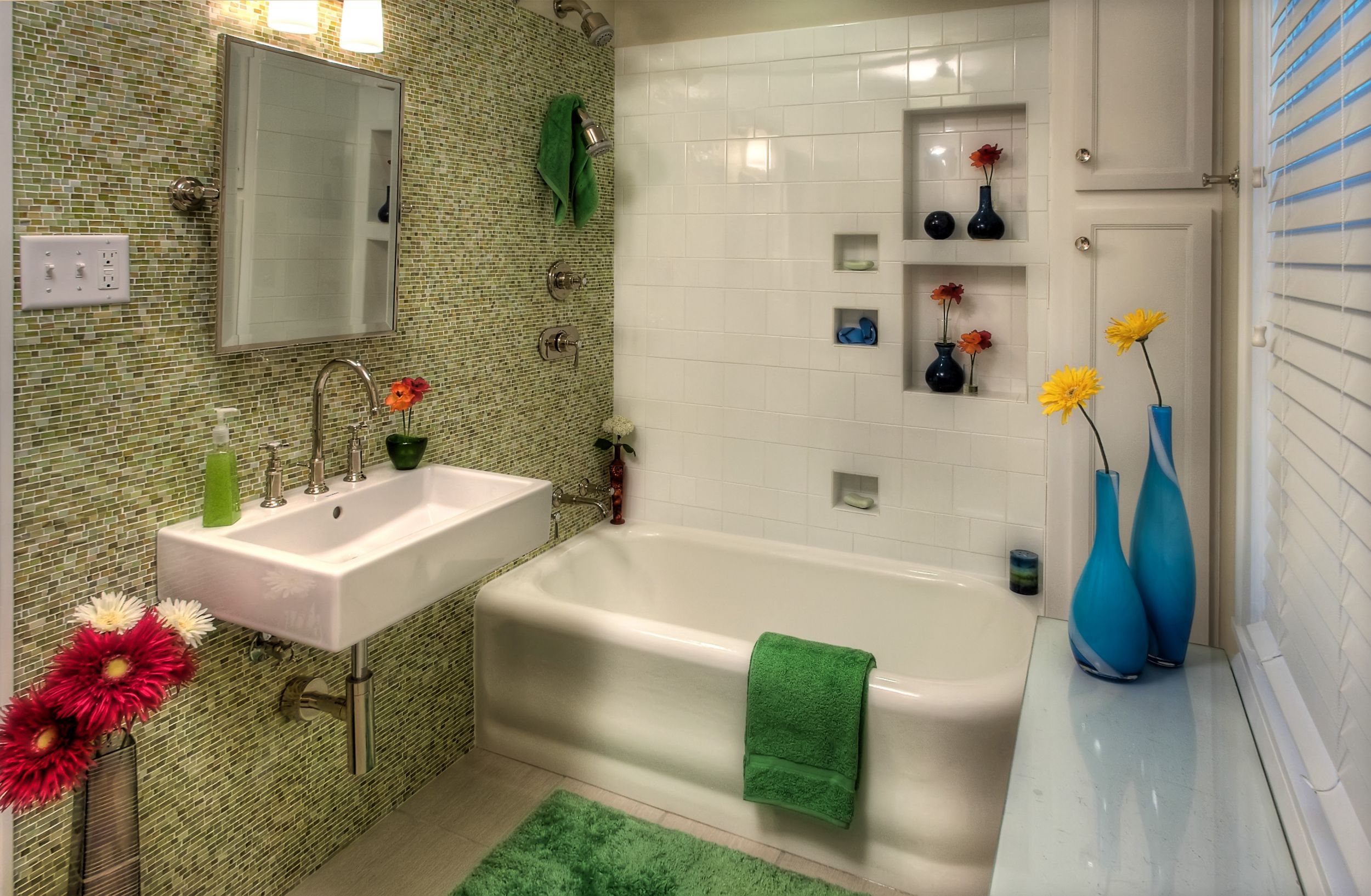 Bathroom remodel with new tile. Green tile accent wall and clean white tile shower wall.