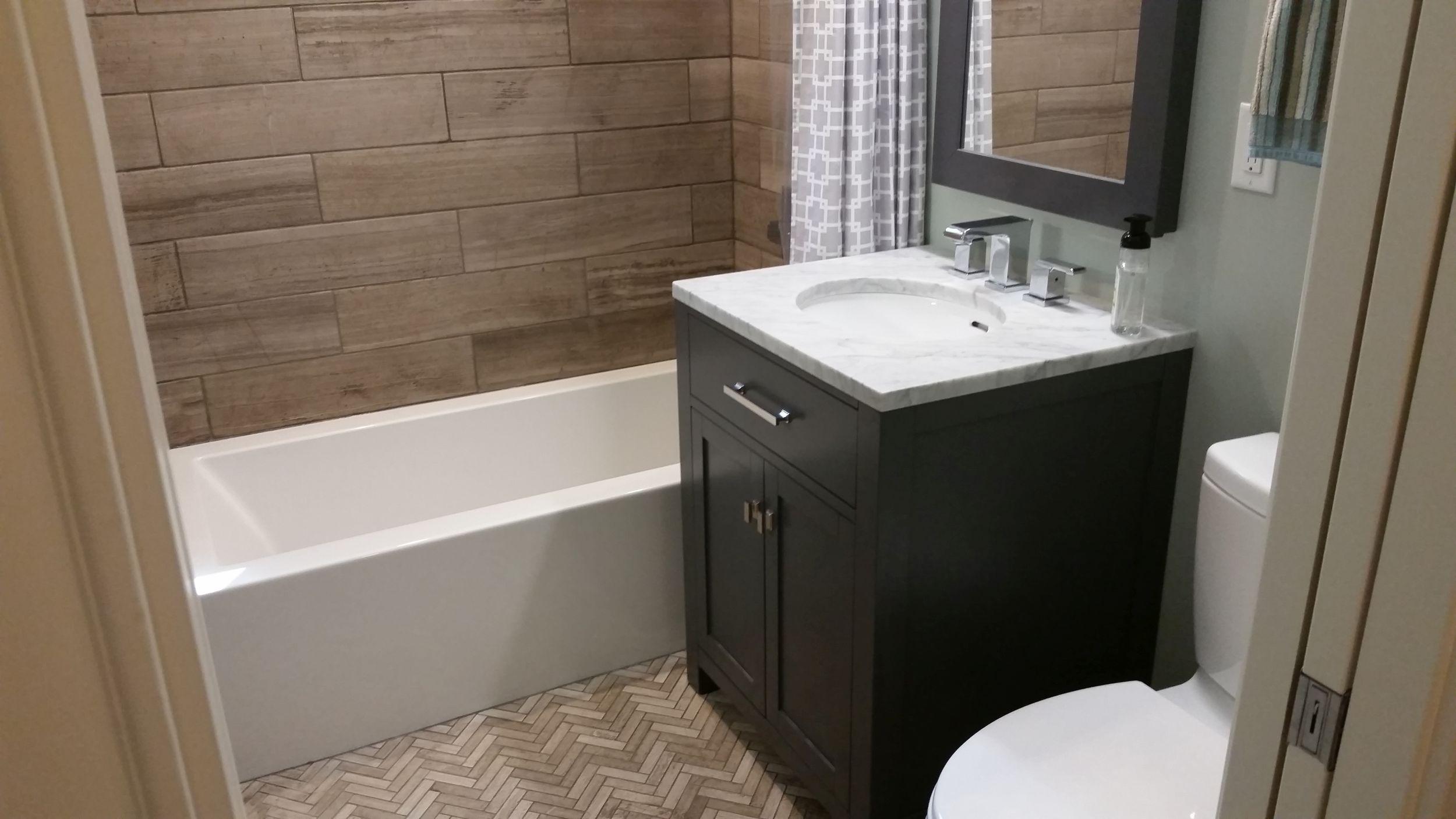 Bathroom remodel after image. New shower and floor tile.