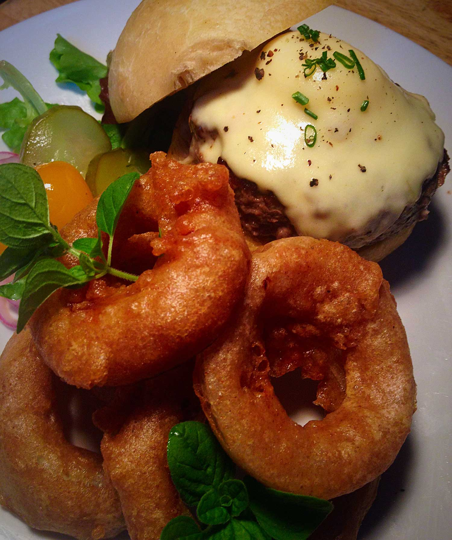 Grass fed beef burger and beer battered onion rings