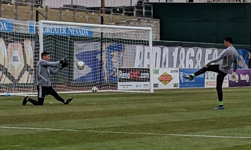 Orange County SC keeper Carlos Lopez warming up before the match, his first USL start.