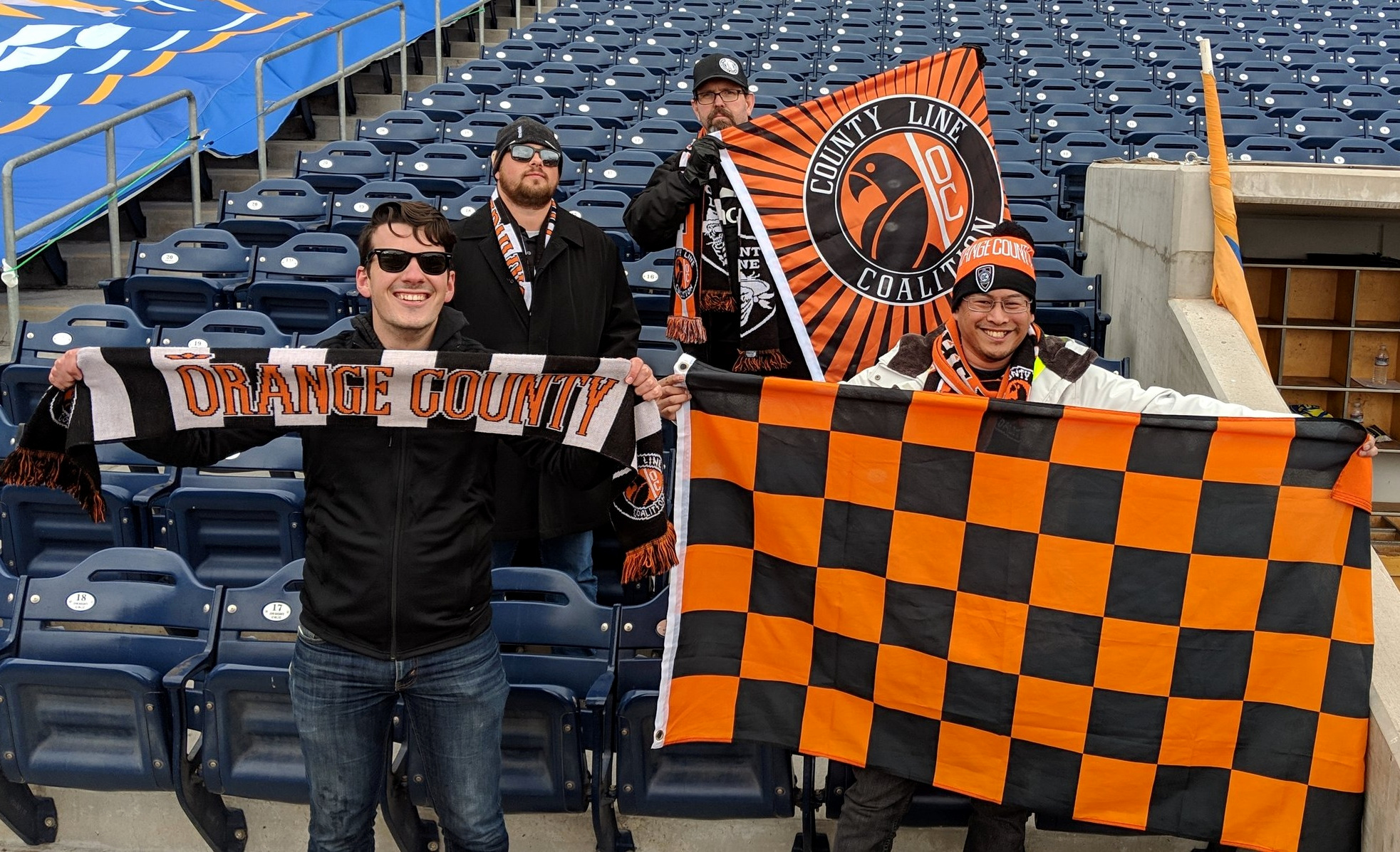 Travelling Orange County SC fans holding up flags that would later go missing at Greater Nevada Field.