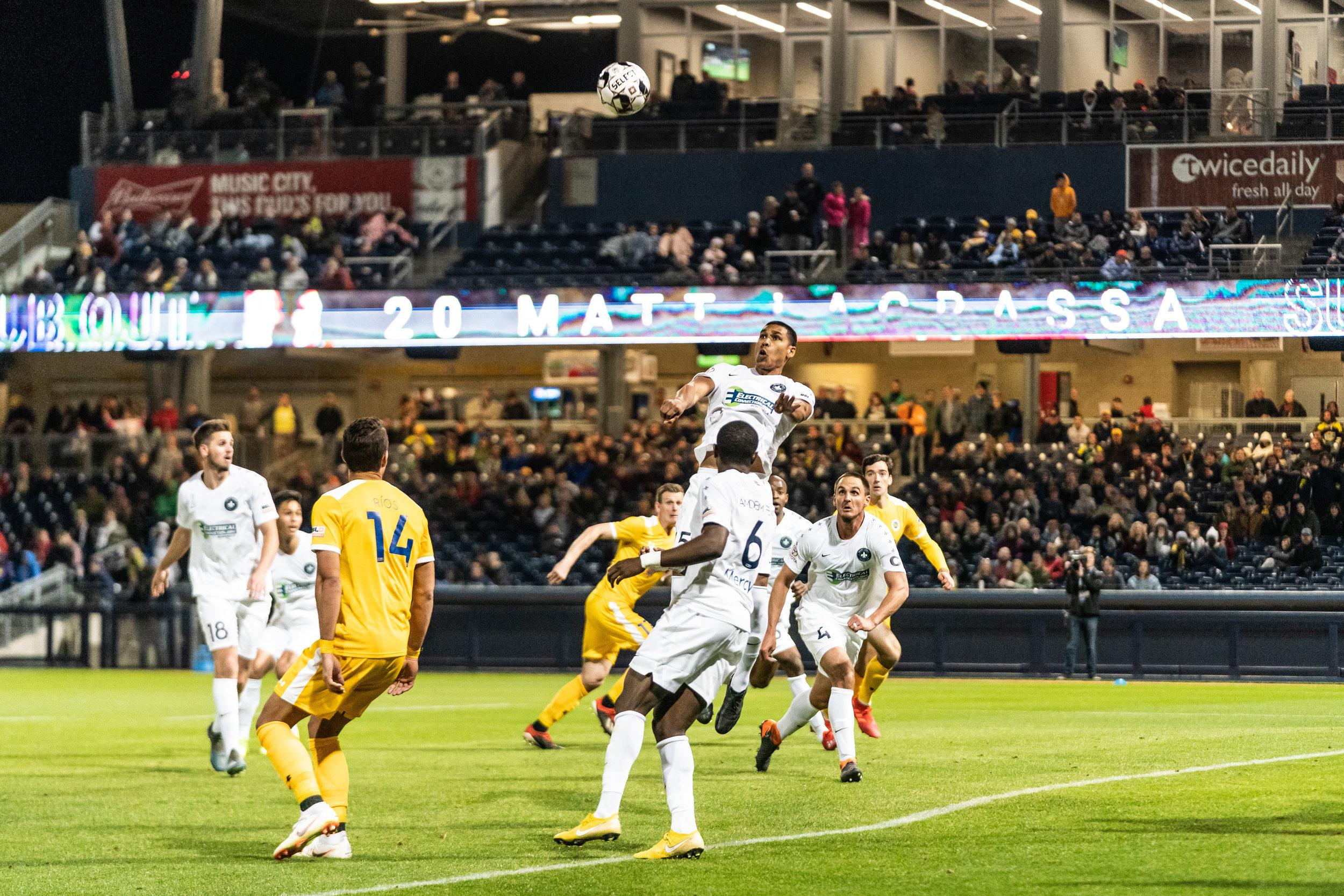 Saint Louis FC defender Sean Reynolds goes high for the header.  |  Photo courtesy of Saint Louis FC