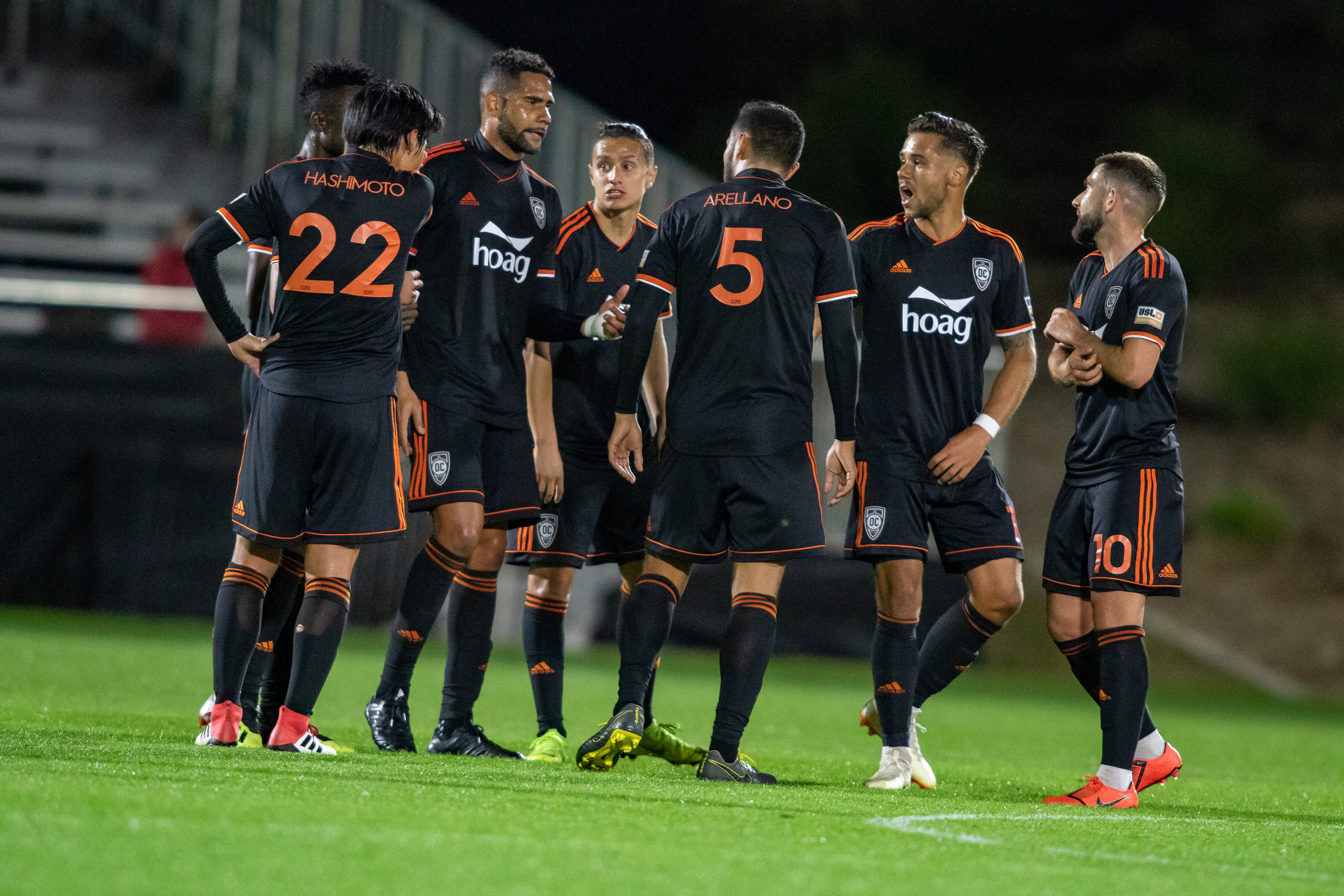 Orange County SC players regroup after giving up 2 goals to New Mexico United  |  Photo courtesy of Orange County SC