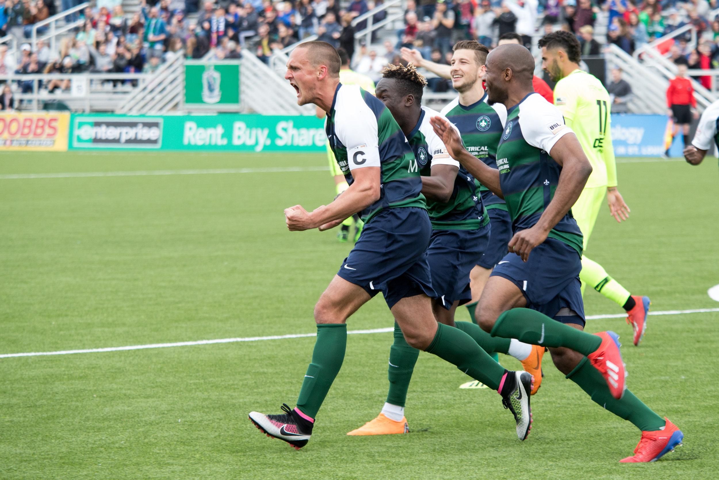 Saint Louis FC captain Sam Fink celebrates with teammates. | Photo courtesy of Saint Louis FC