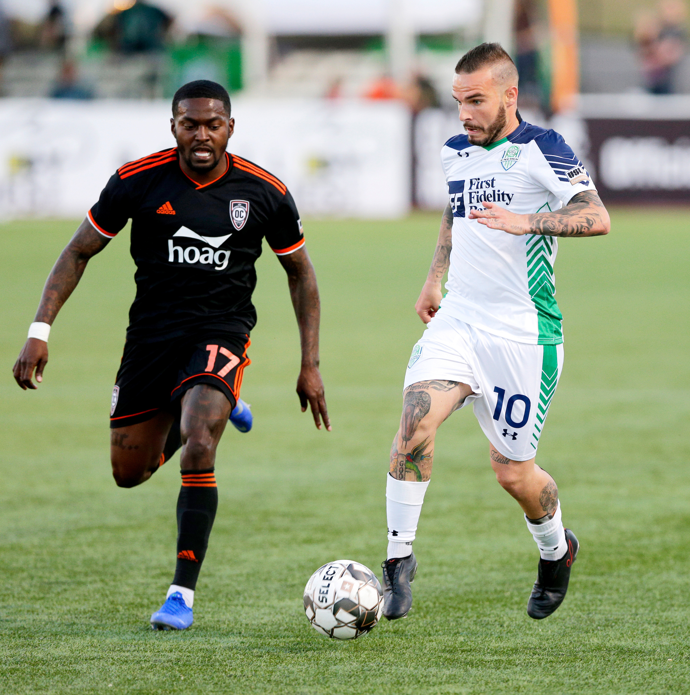 Orange County SC winger Darwin Jones attempts to get the ball from OKC Energy FC's Alexy Bosetti in their 1-0 loss.  |  Photo courtesy of OKC Energy FC