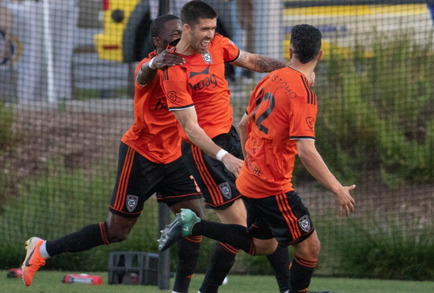 Orange County SC's Aodhan Quinn celebrates with teammates after converting on a penalty in the 1st half of their 2-1 win over Phoenix Rising FC on Saturday.  |   Photo courtesy of Orange County SC