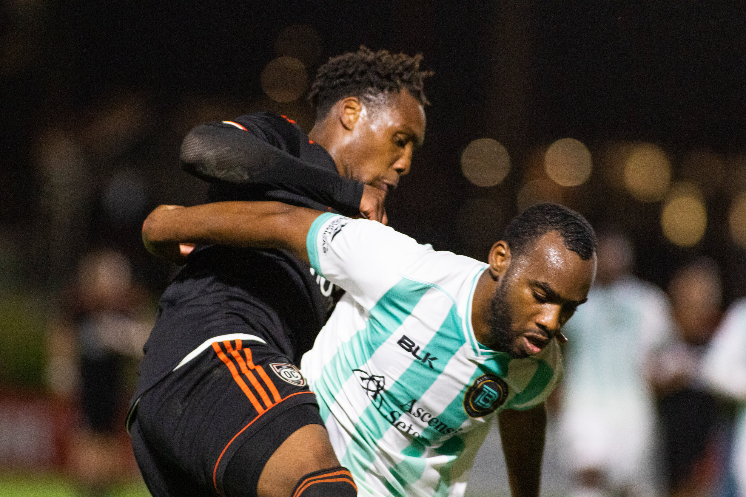 Orange County SC forward Michael Seaton battles with an Austin Bold FC defender in there 2-2 draw.  |   Photo courtesy of Orange County SC/Liza Rosales