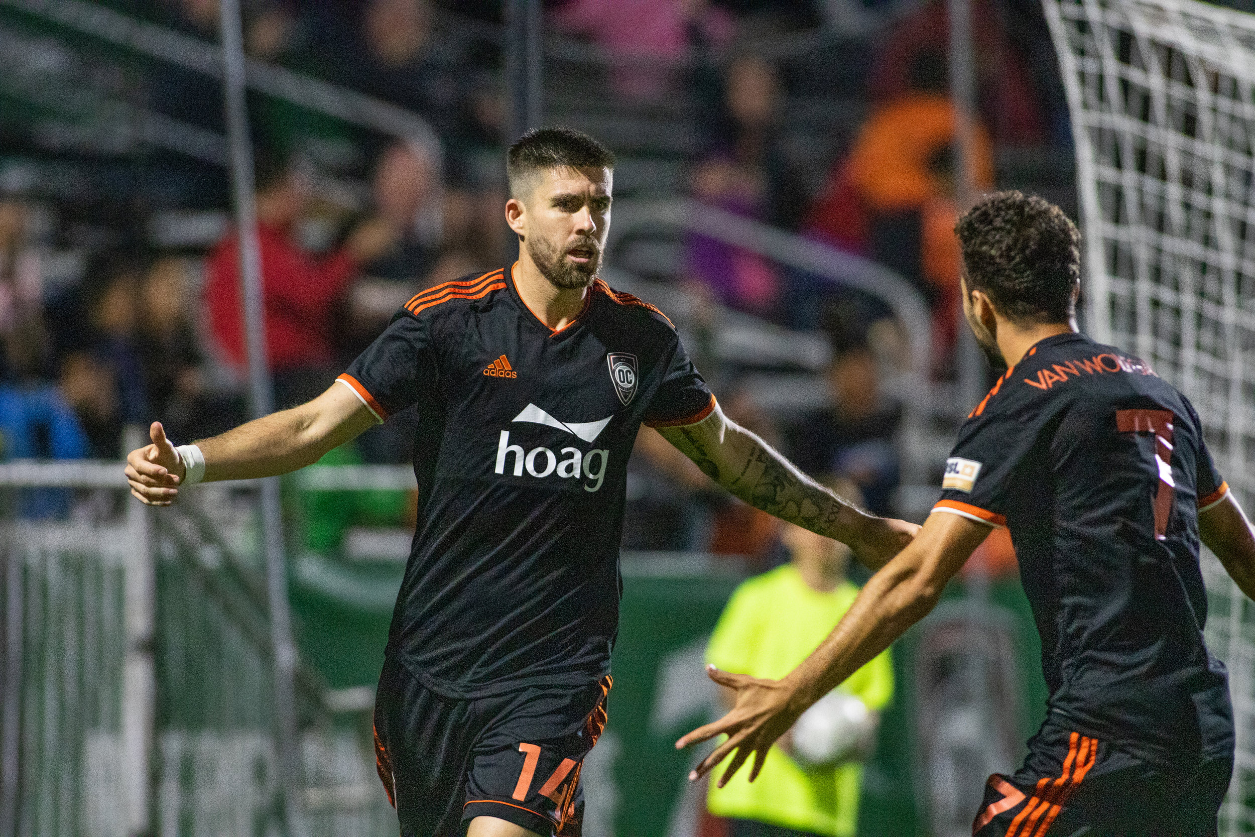 Orange County SC midfielder Aodhan Quinn celebrates with teammate Jerry van Wolfgang after scoring in their 2-2 draw against Austin Bold FC.  |   Photo courtesy of Orange County SC/Liza Rosales