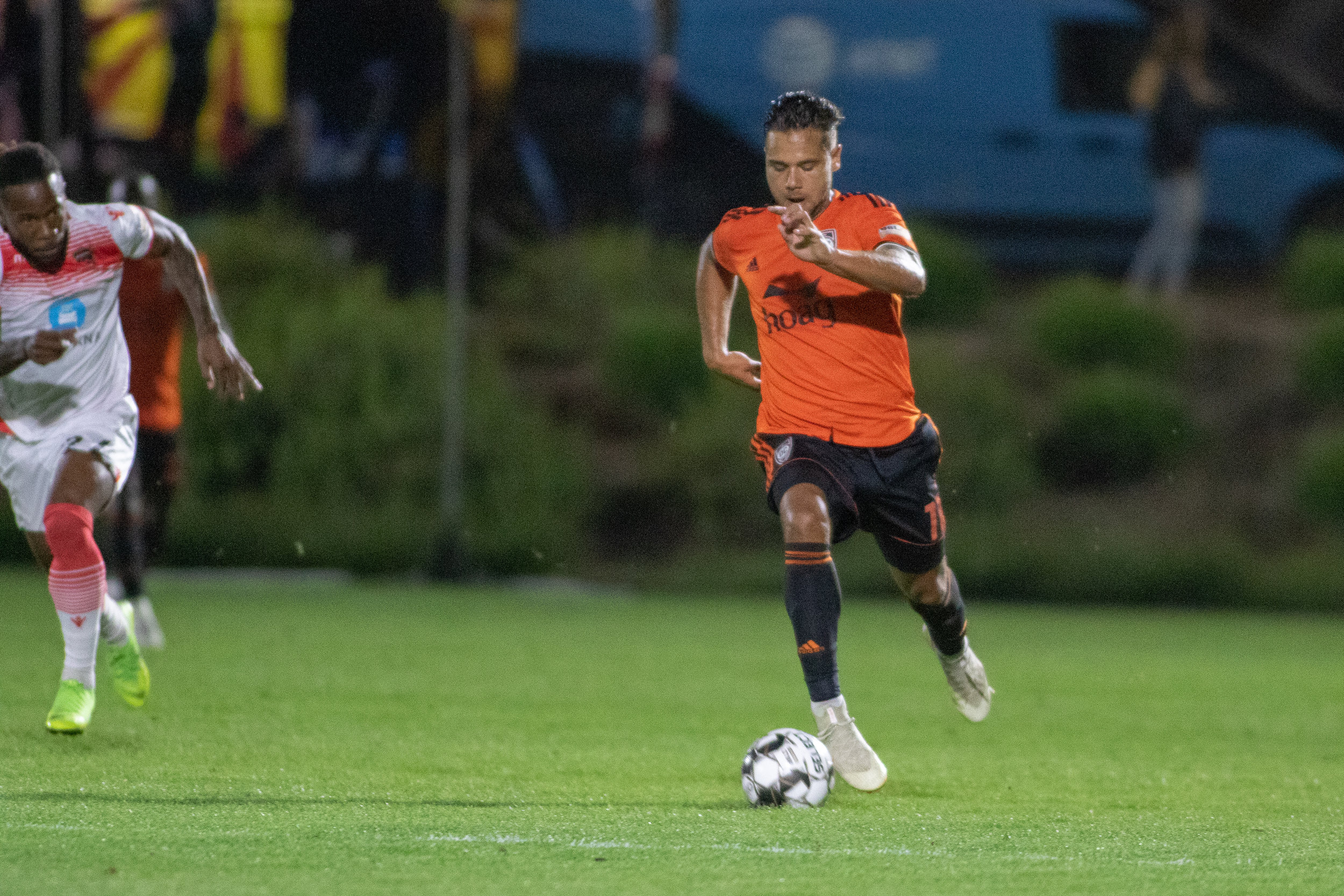 Orange County SC's Harry Forrester dribbles past a Phoenix Rising FC defender.  |   Photo courtesy of Orange County SC/Liza Rosales