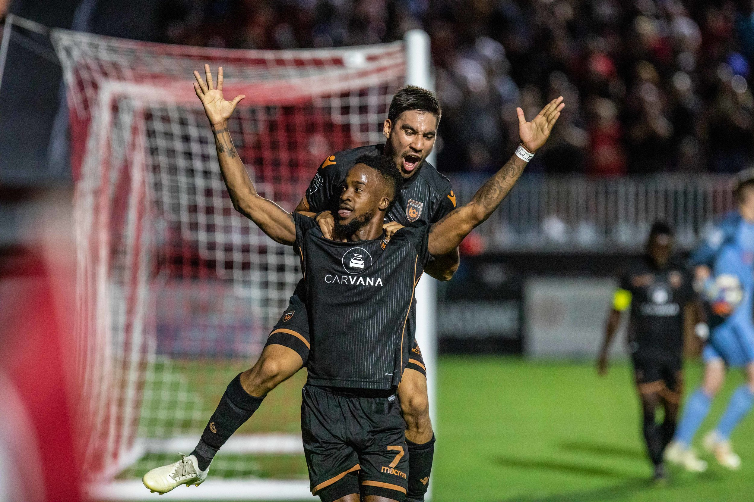 Phoenix Rising FC's Junior Flemmings celebrates during their 5-0 victory over Tulsa Roughnecks FC. |  Photo courtesy of   Michael Rincon/PHXRisingFC.com