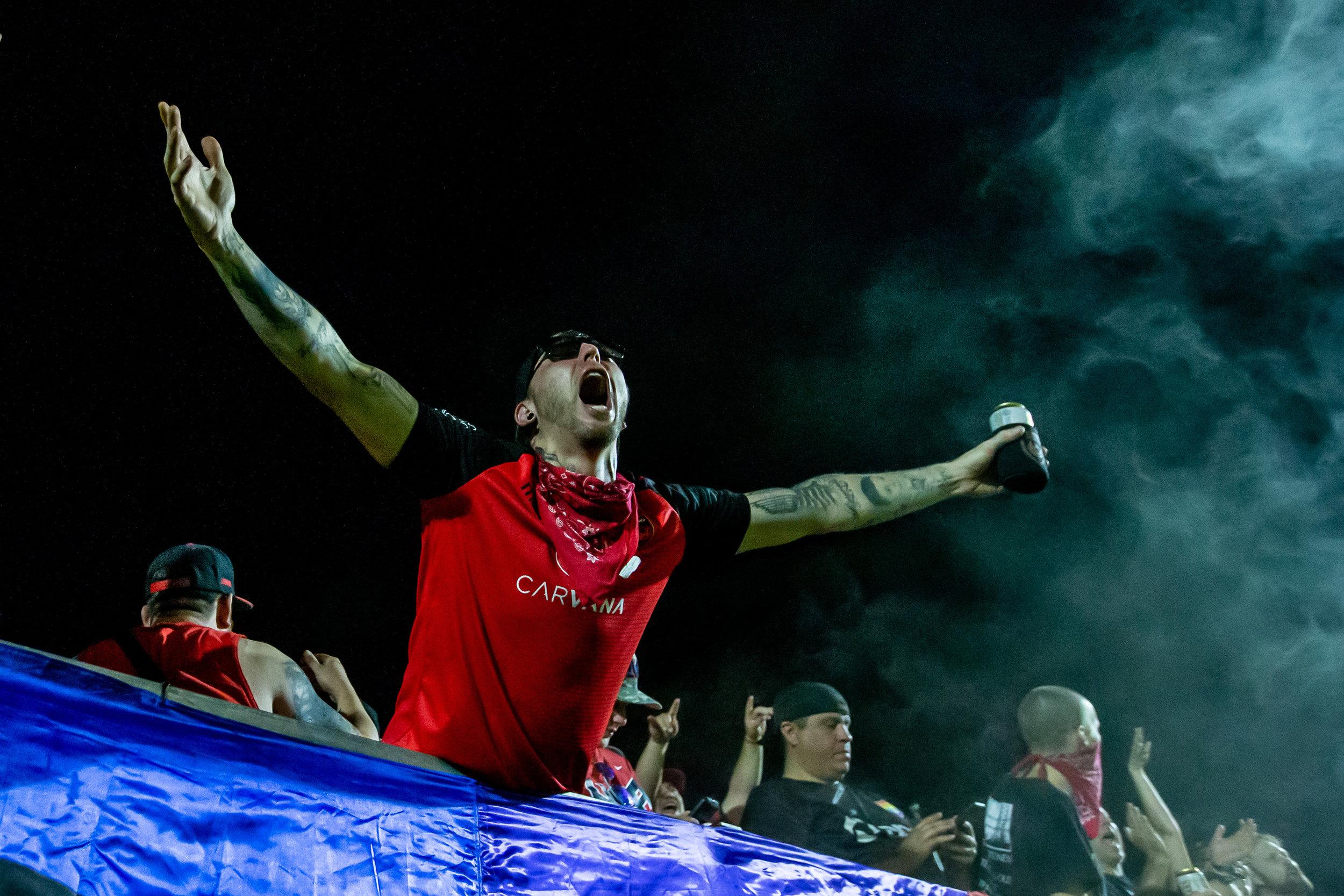 A Phoenix Rising FC fan celebrates in the team's 3-0 win over Orange County SC.  |   Photo courtesy of Michael Rincon/PHXRisingFC.com