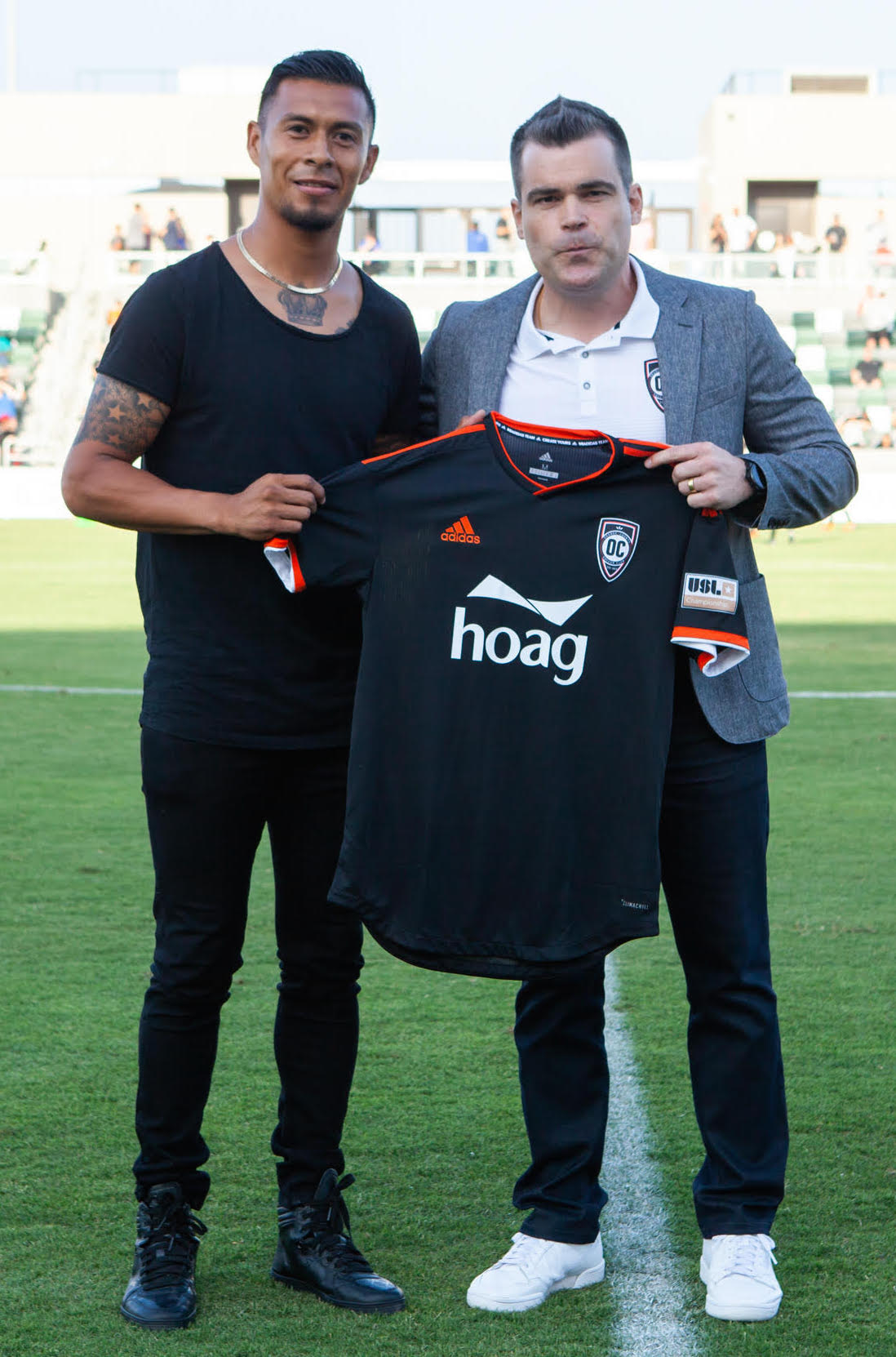 Michael Orozco with General Manager Oliver Wyss. Photo courtesy of Orange County SC/Liza Rosales