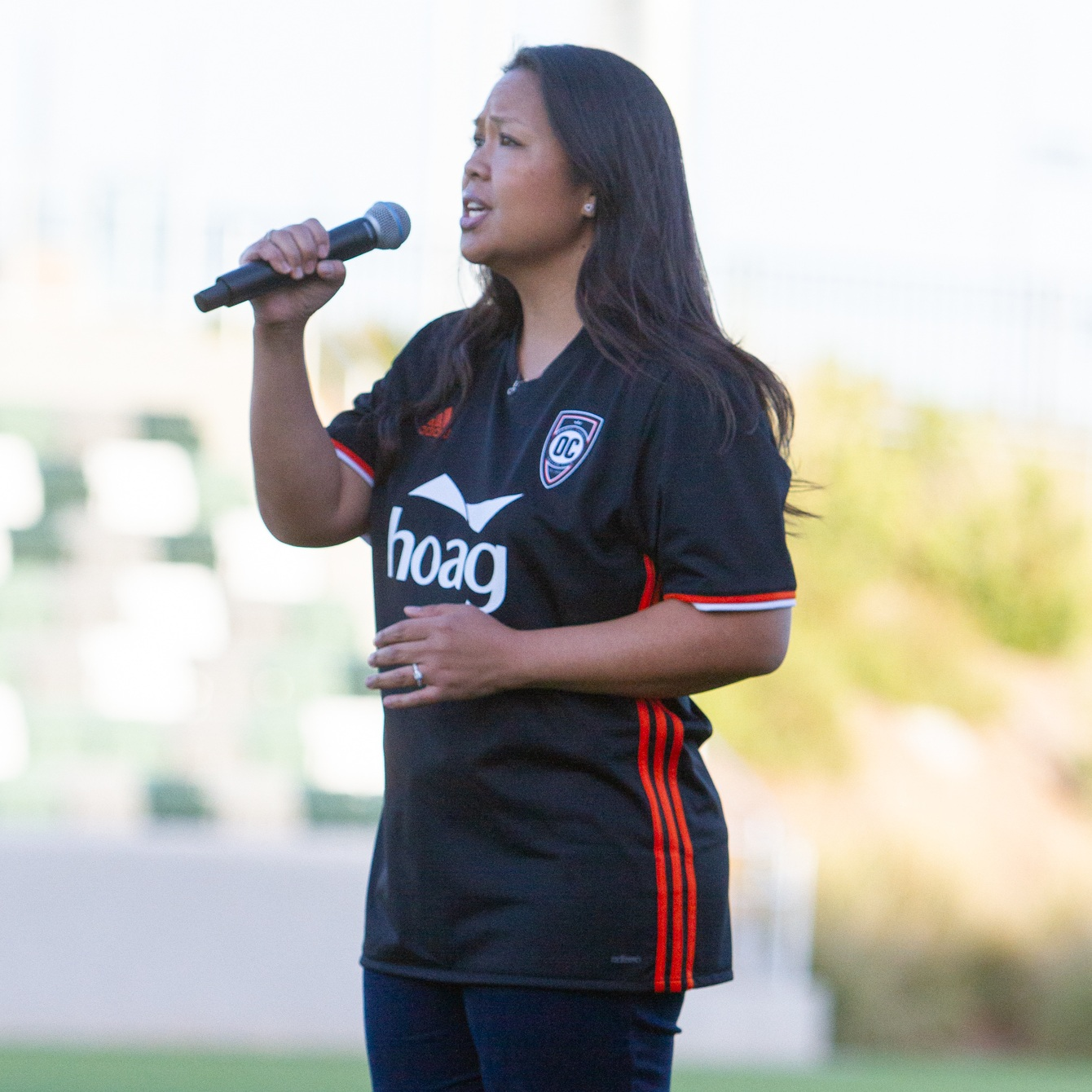 Katrina sings the national anthem at a recent match at Championship Soccer Stadium. | Photo courtesy of Orange County SC/Liza Rosales