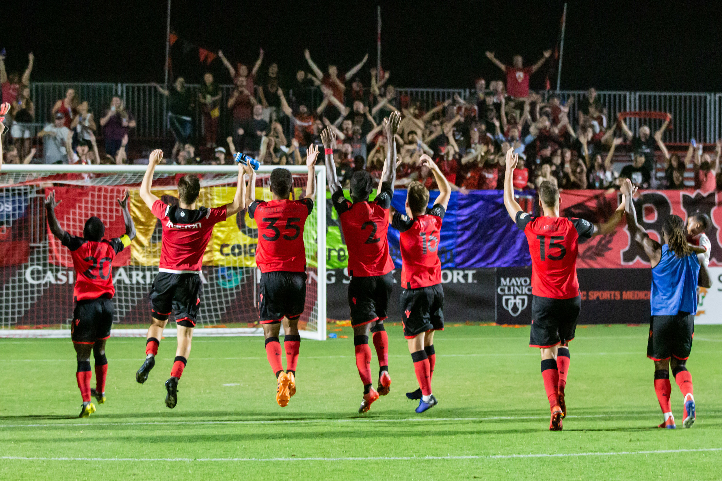 Phoenix Rising FC players acknowledge their supporters after their win over Orange County SC. |  Photo courtesy of Michael Rincon/PHXRisingFC.com