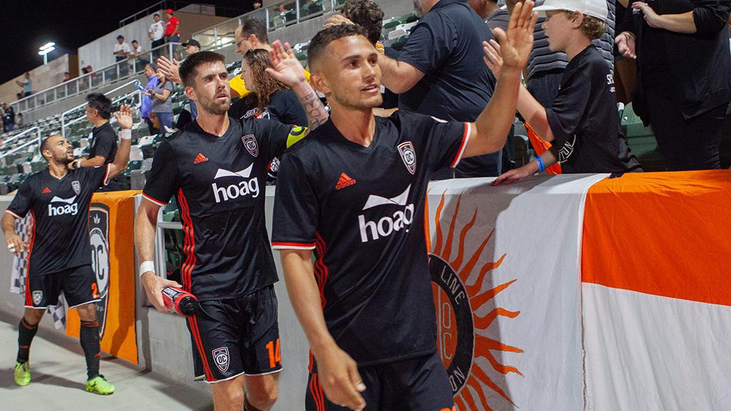 Christian Duke leads the line of players thanking supporters after a 2-0 victory over Swope Park Rangers in August 2018.  Photo courtesy of Liza Rosales/Orange County SC.