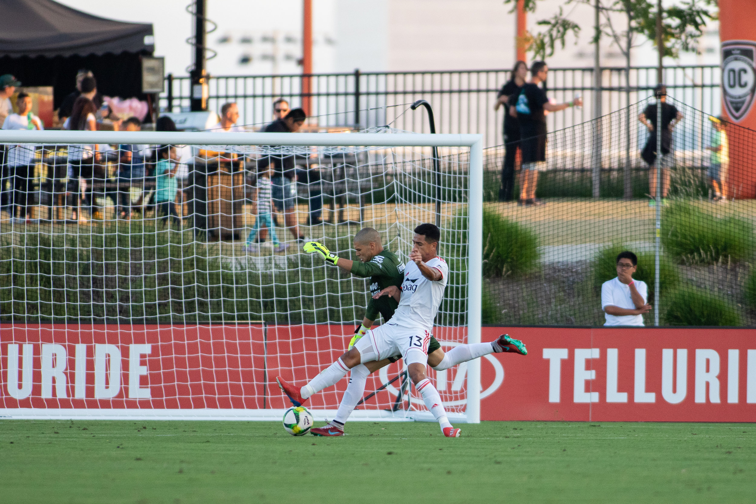 Vinicius closing down the Tijuana goalkeeper early on in the two teams' friendly on June 27.  Photo credit: Liza Rosales/ Orange County SC .