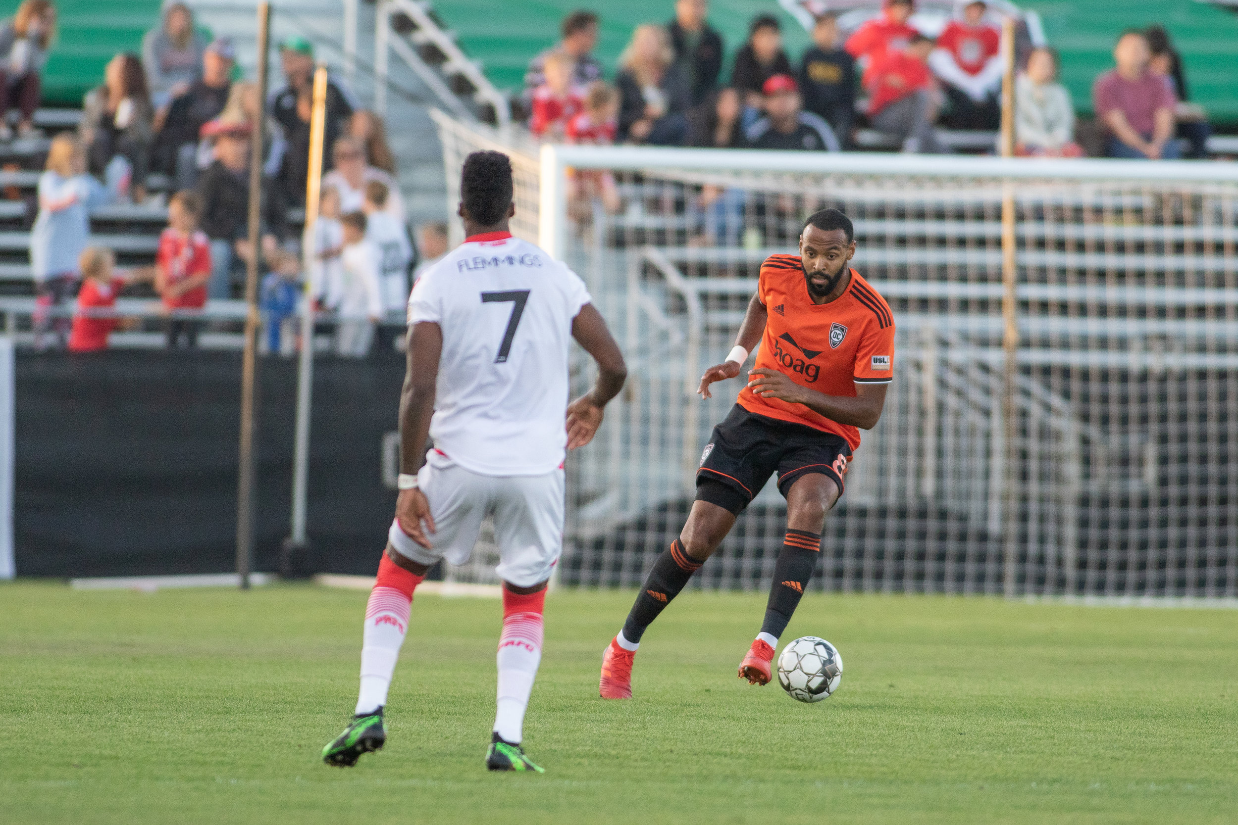 Trotter, right, on the ball in the OC half against Phoenix Rising FC on May 4, 2019.  Photo courtesy of Liza Rosales/ Orange County SC.