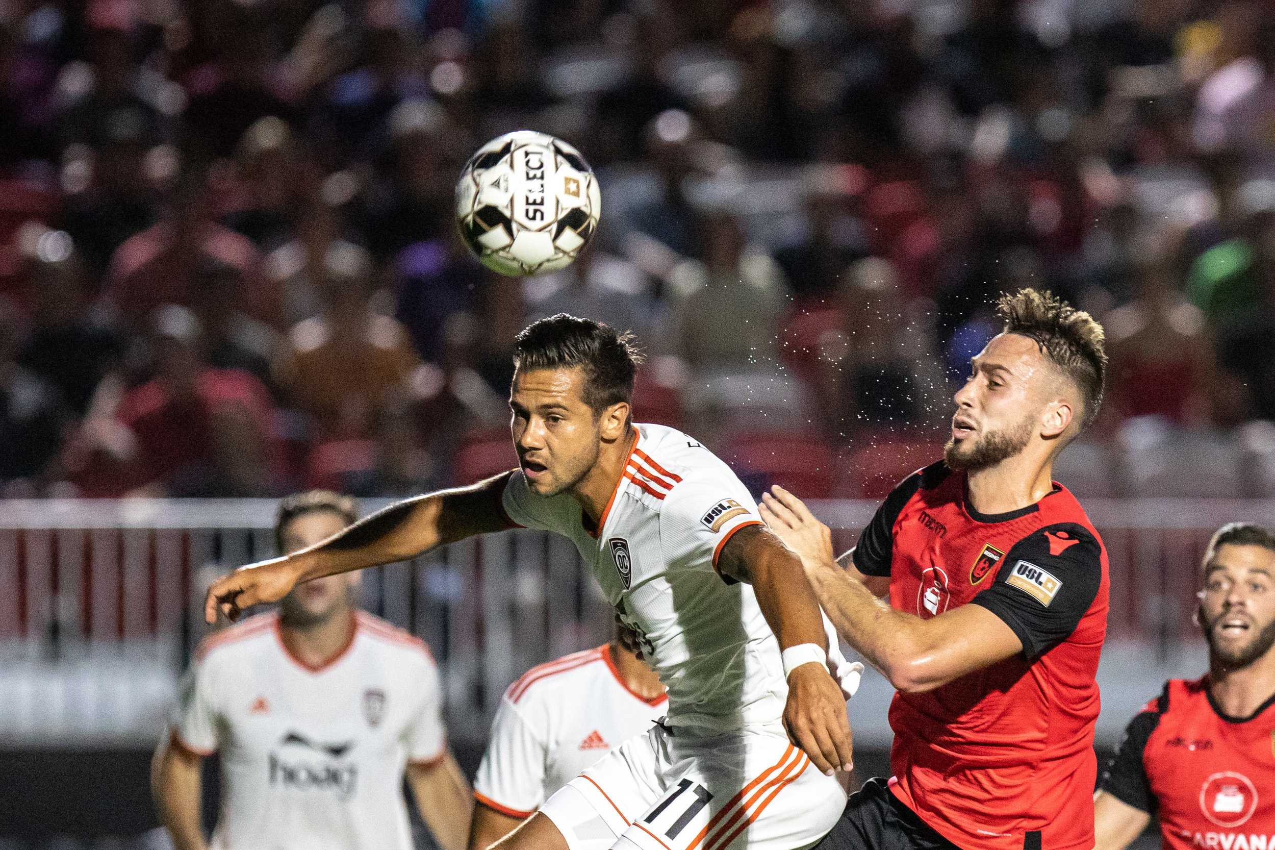 Orange County SC's Harry Forrester gets his head on the ball against Phoenix Rising FC. | Photo courtesy of Michael Rincon/PHXRisingFC.com
