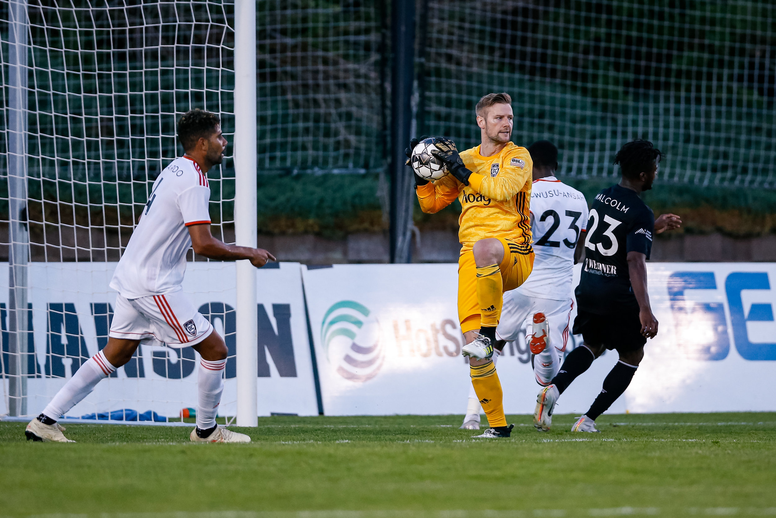 Patrick McLain protects the ball after making one of his 3 saves against Colorado Springs Switchbacks FC. |  Photo courtesy of Isaiah J. Downing