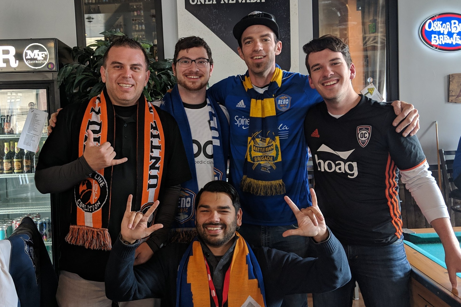 The hosts of Orange & Black SoccerCast and 1868 Weekly hang out before the 2019 USL season opener between Orange County SC and Reno 1868 FC.  |   Photo courtesy of Orange & Black SoccerCast/Ray Samora