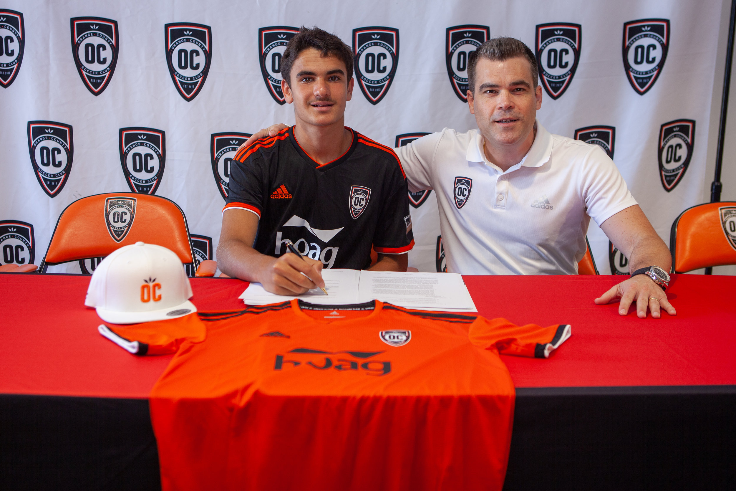 14-year-old Jacob Francis signs his contract with Orange County SC, making him the youngest ever American male to sign a professional contract.  |   Photo courtesy of Orange County SC/Liza Rosales