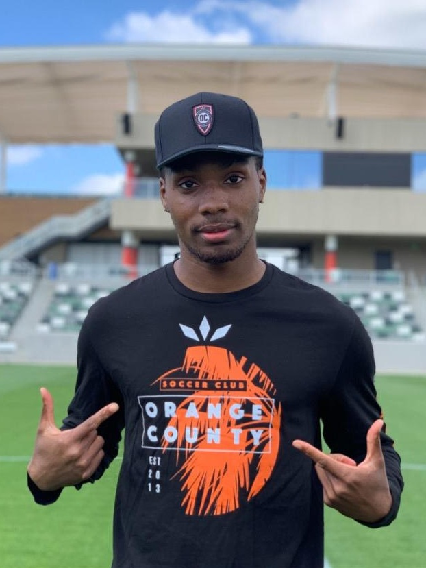 Orange County SC forward Michael Seaton shows off one of the shirts from the team's Lifestyle Apparel brand. |  Photo courtesy of Orange County SC