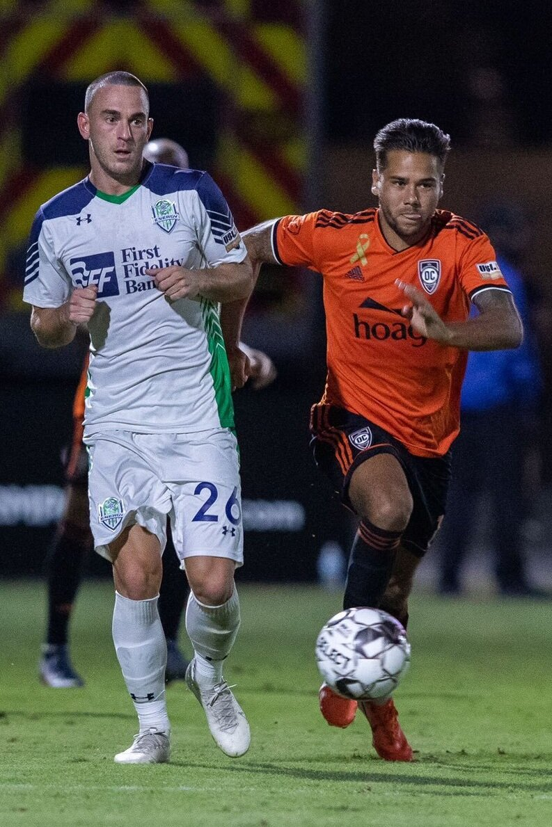 Orange County SC midfielder Harry Forrester dribbles the ball in their playoff clinching victory over OKC Energy FC on Saturday night. |  Photo courtesy of Orange County SC/Liza Rosales