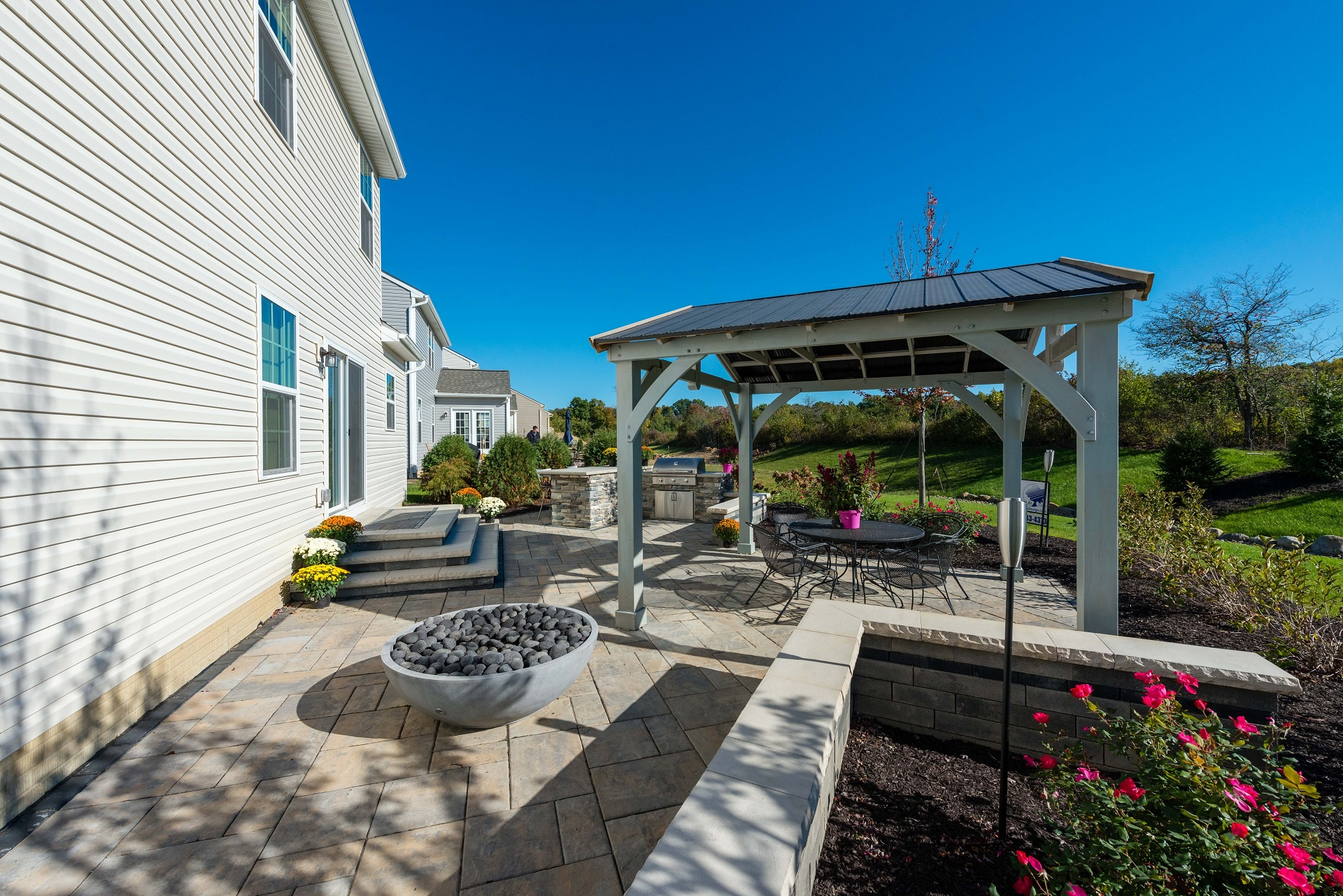 Brick patio, pergola and outdoor fireplace in Chagrin Falls OH