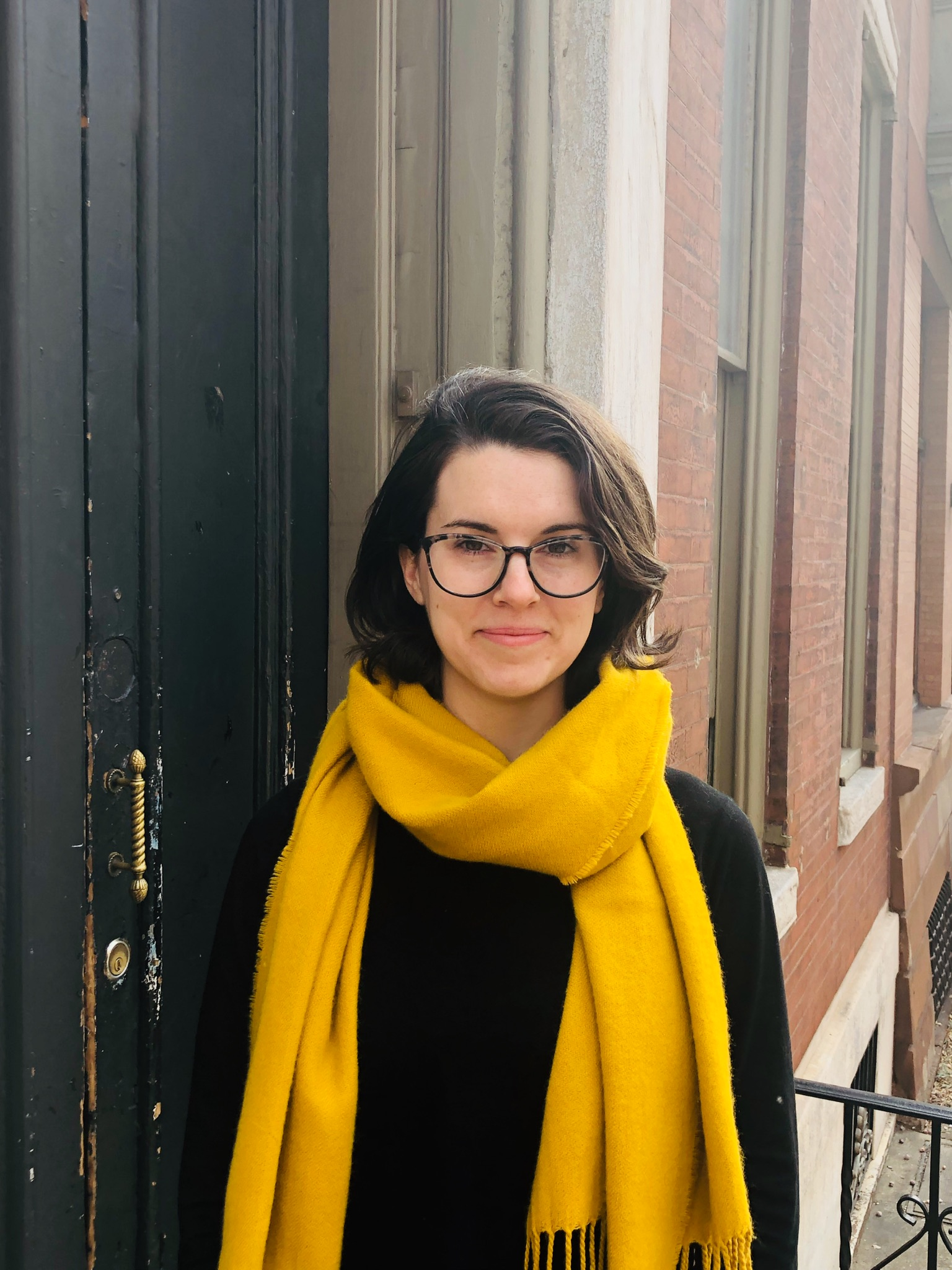 Embry Wood Owen, a white woman wearing glasses and a yellow scarf