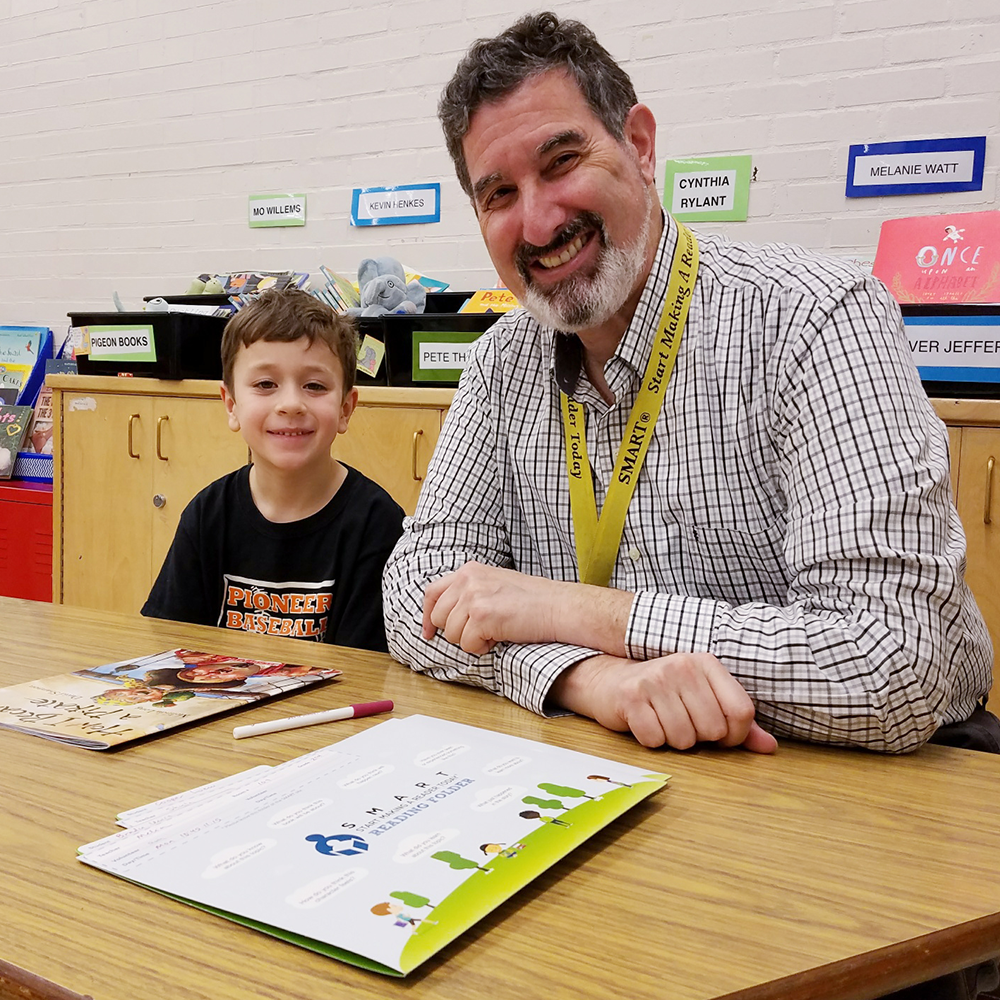 The Start Making a Reader Today has helped kids read and succeed, connecting them with volunteers like NW Natural's Randy Friedman.
