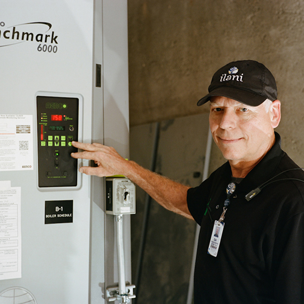 Dan Lincoln, building employee at ilani Casino Resort, demonstrates the control panel on a high-efficiency condensing boiler. The resort will save more than $40,000 annually thanks to energy-efficient equipment.
