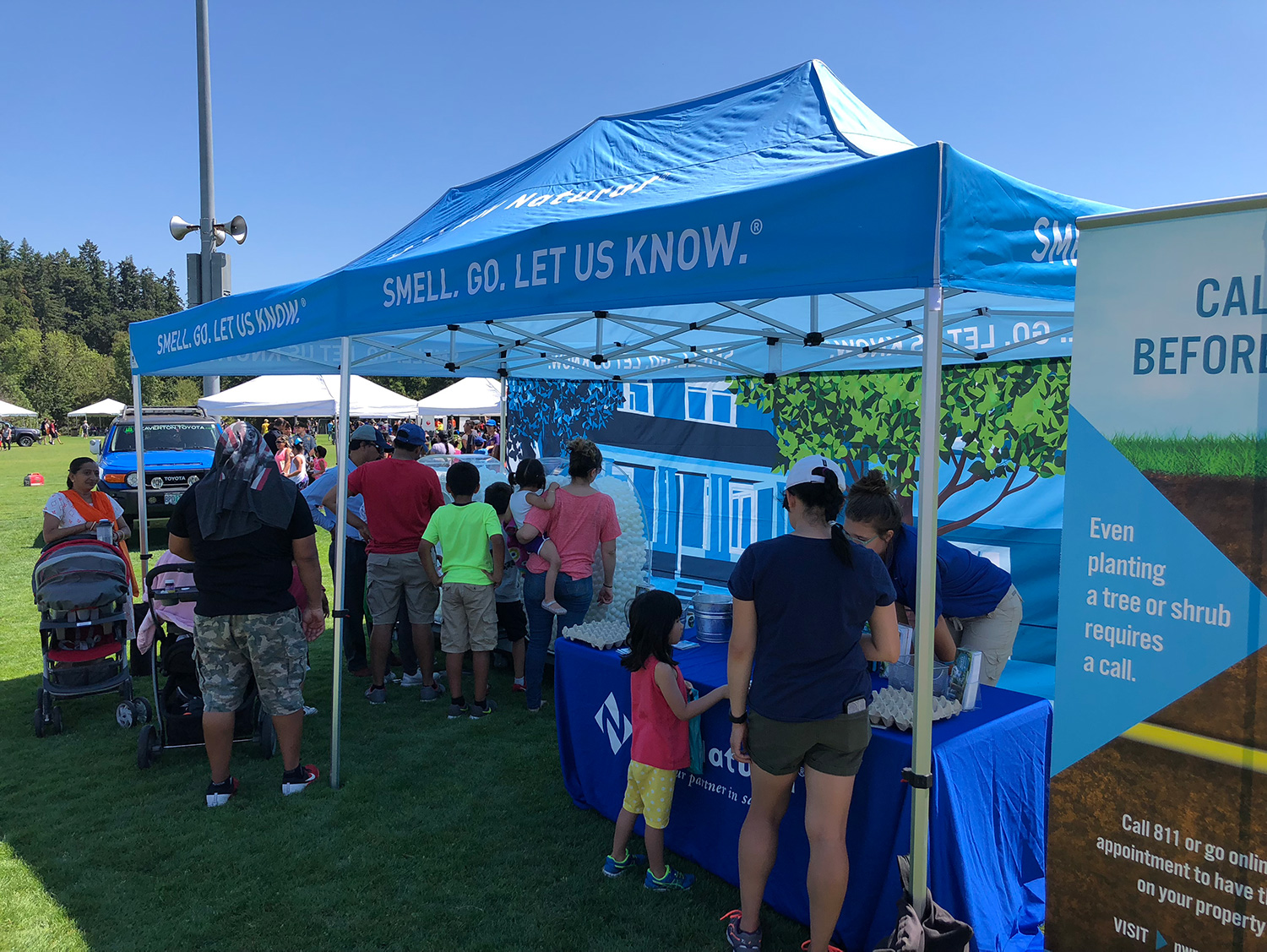 NW Natural reps share information with visitors to the company's safety exhibit at events all summer long.