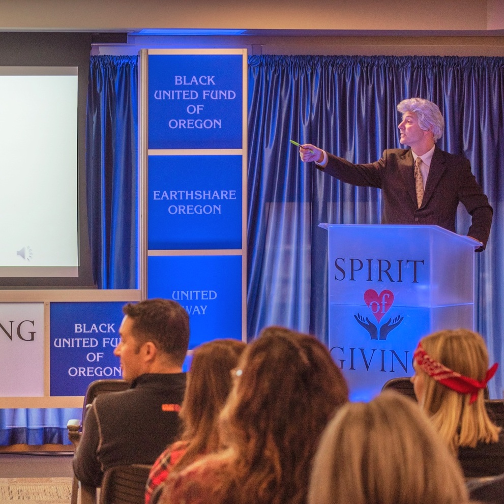 "NW Natural hosts ""Alan Trebek"" (actor Bruce Broussard) for the 2018 Spirit of Giving employee fundraising campaign kickoff."