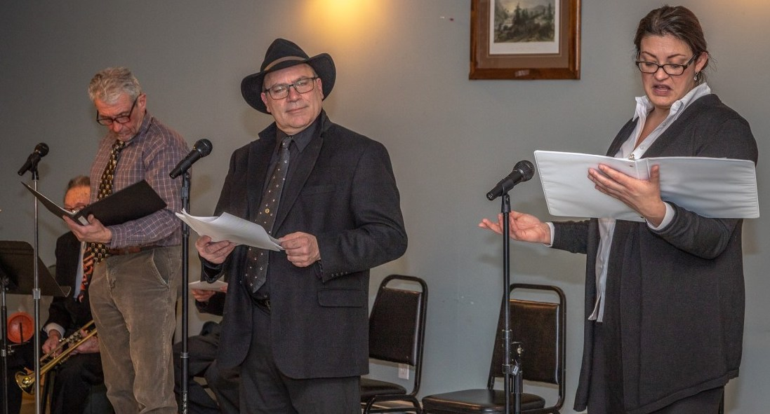 "Tom Stock, Bob Gassmann, and Katie Drake, regulars in the noir detective series, as they appeared in the most recent of the Mac Blac plays, ""Where's the Brass Lantern?"""